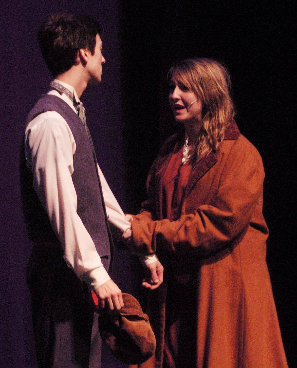 "Jake Rosko as Manus and Jordyn Withey as Eponine rehearse for the weekend production of ""Les Miserables"" at Kaneland High School."