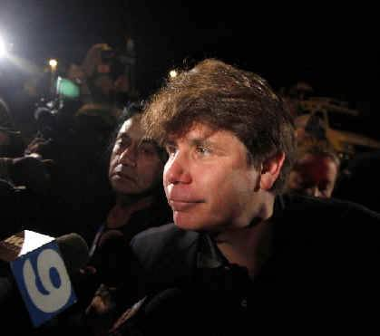 Rod Blagojevich outside his Chicago home this morning, headed for the airport.