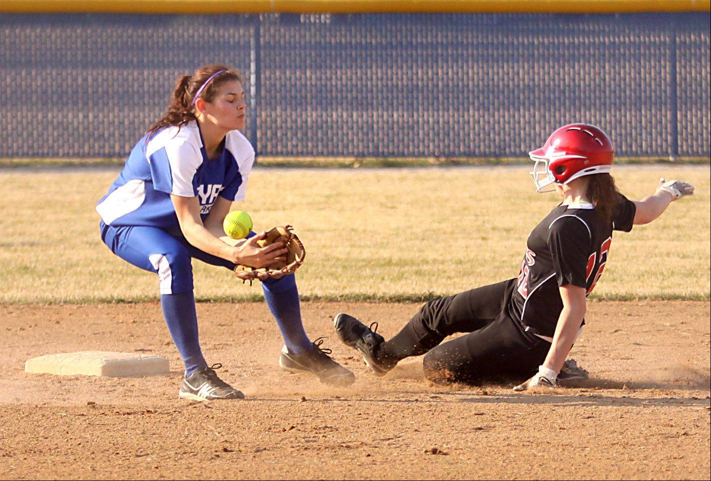 Larkin's Jaclyn Saurbaugh, left, fields the throw as Maine South's Michelle Roberts, right, slides safely into second base with a first-inning steal during a varsity softball game at Elgin on Thursday evening.
