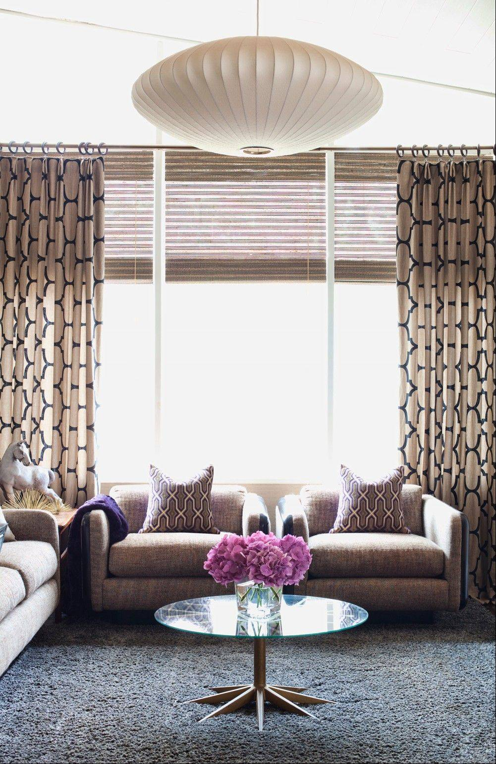 Interior designer Brian Patrick Flynn uses texture in the pillows and drapery to show off the windows in this living room.