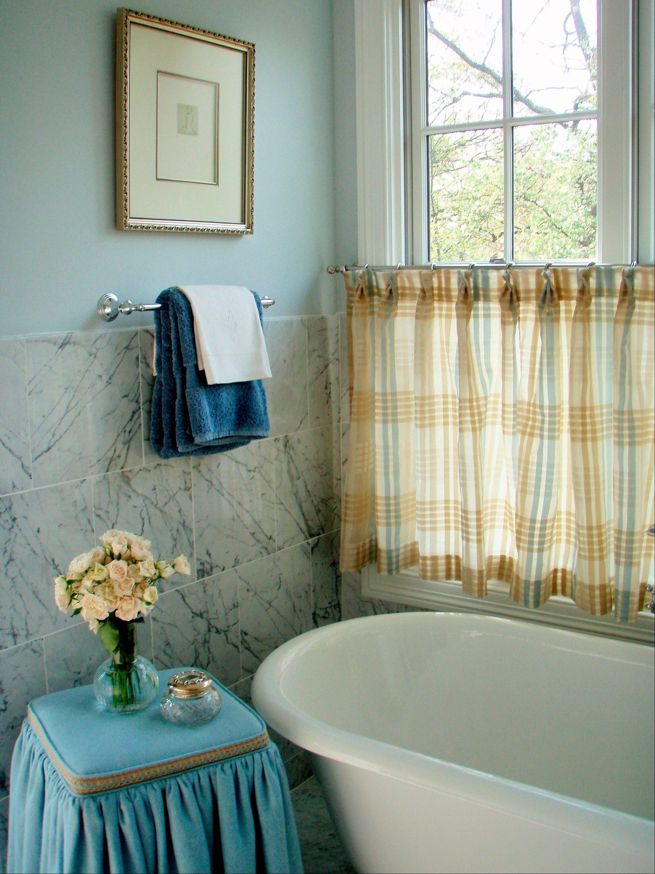 Atlanta-area designer Mallory Mathison uses a simple window dressing in this bathroom.