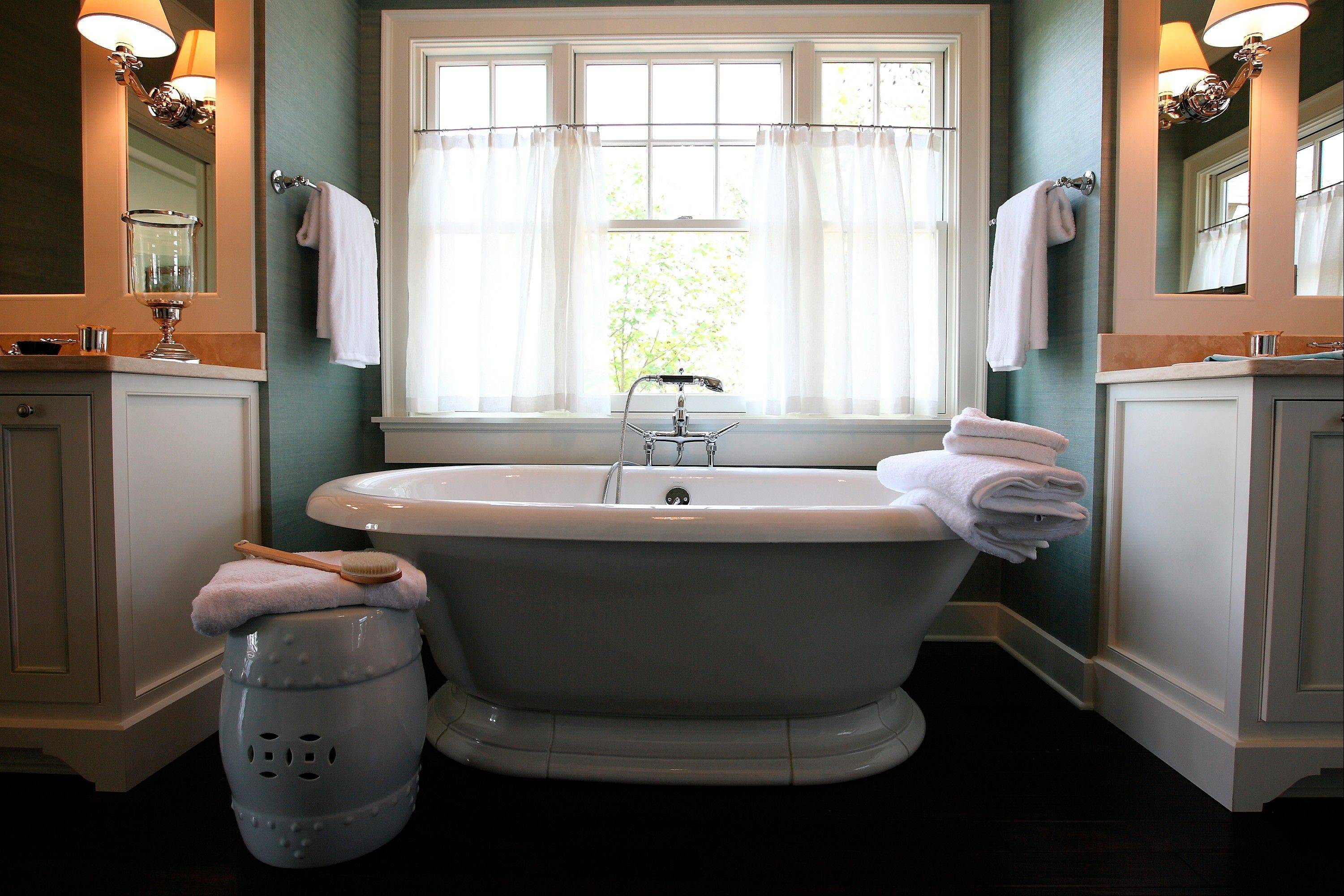 The sheer treatment adds to the airy feeling in this bathroom, designed by Mallory Mathison Inc.
