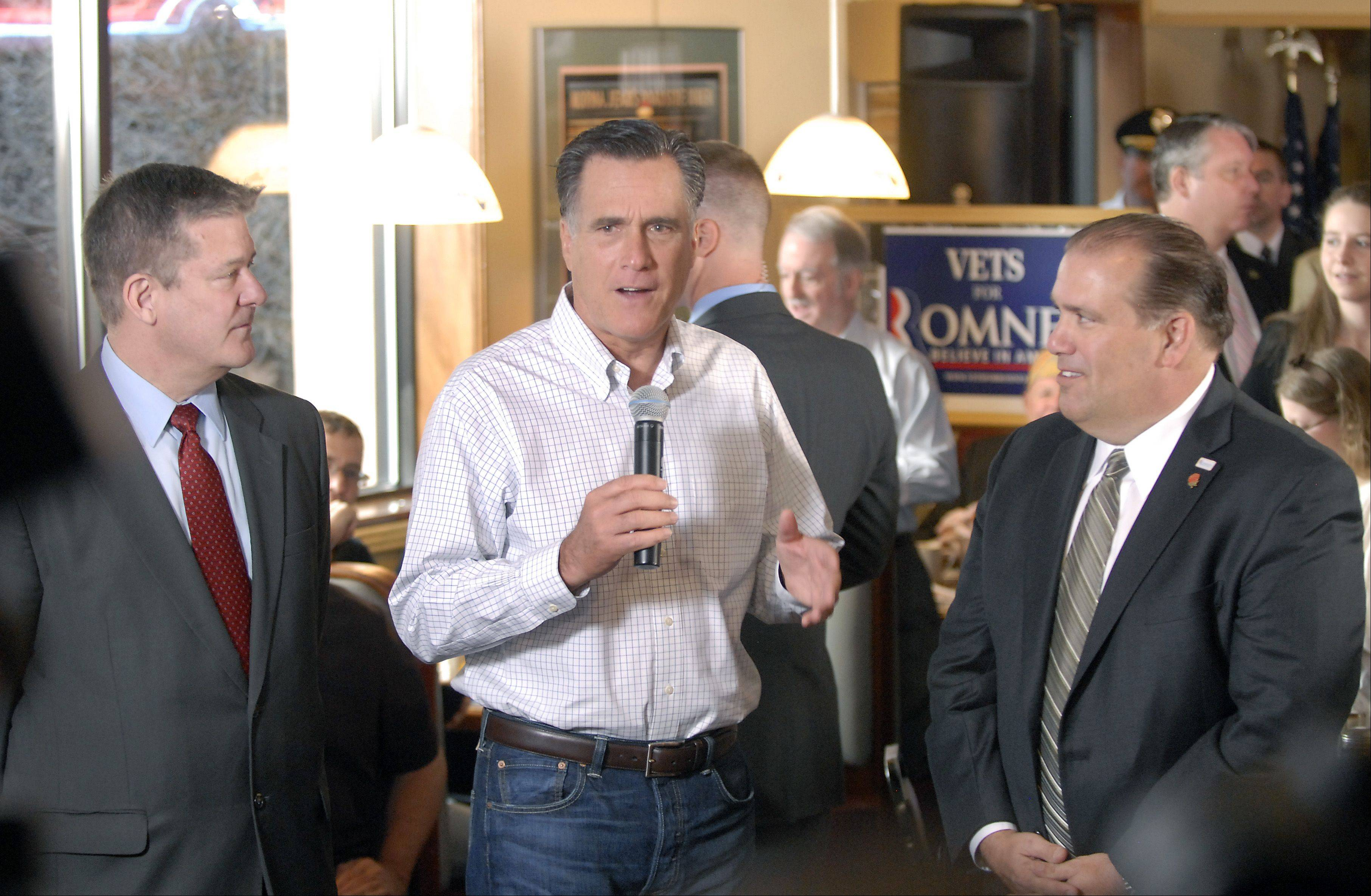 Republican Presidential candidate Mitt Romney, center, is joined by Illinois State Treasurer Dan Rutherford, left, and Rosemont Mayor Bradley Stevens early Friday morning at a restaurant in Rosemont.