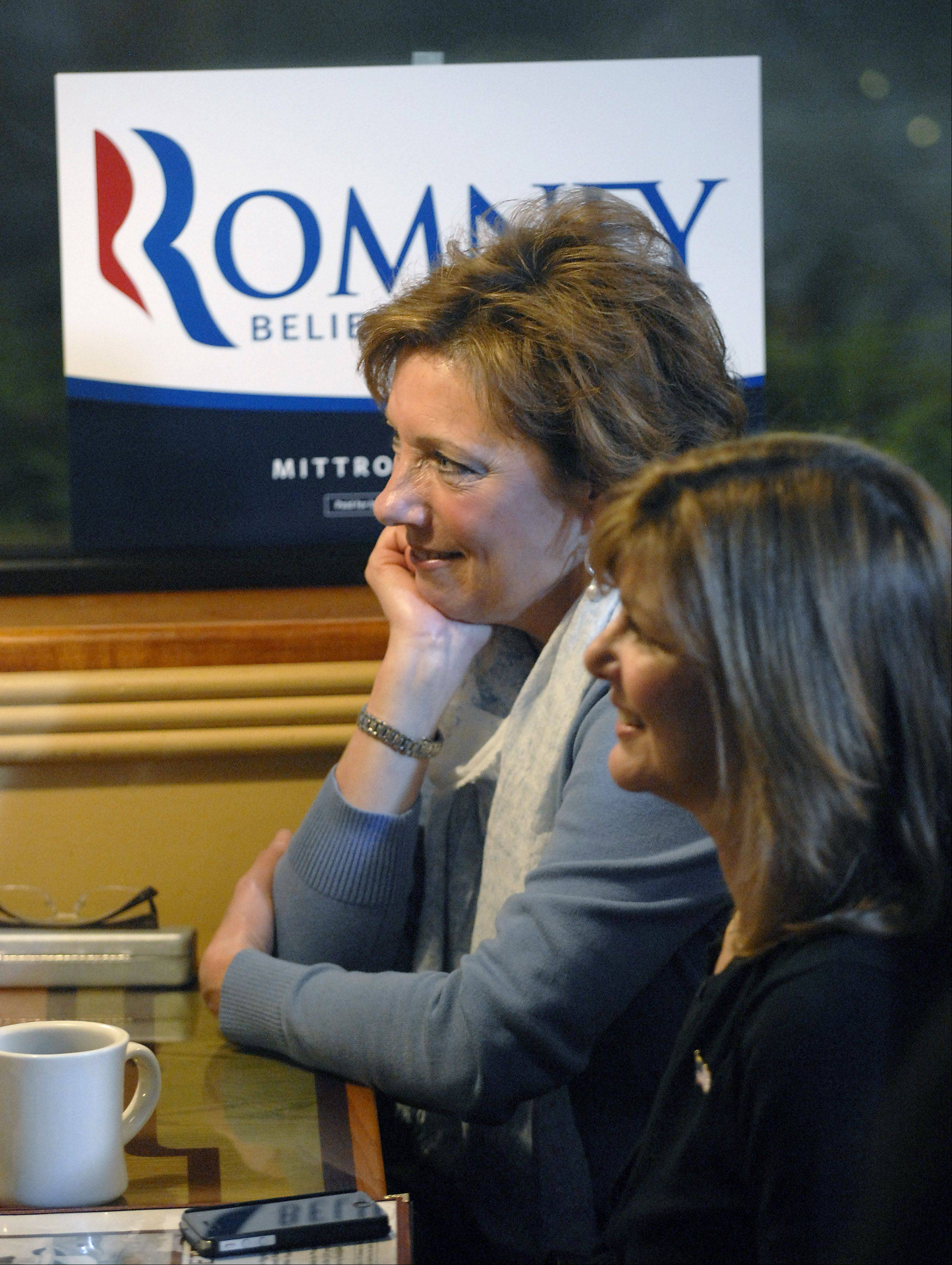 Debbie Weisshappel, left, and Kim Pesavento, both of Barrington, wait for GOP Presidential candidate Mitt Romney early Friday morning at the Pancakes Eggcetera restaurant in Rosemont.