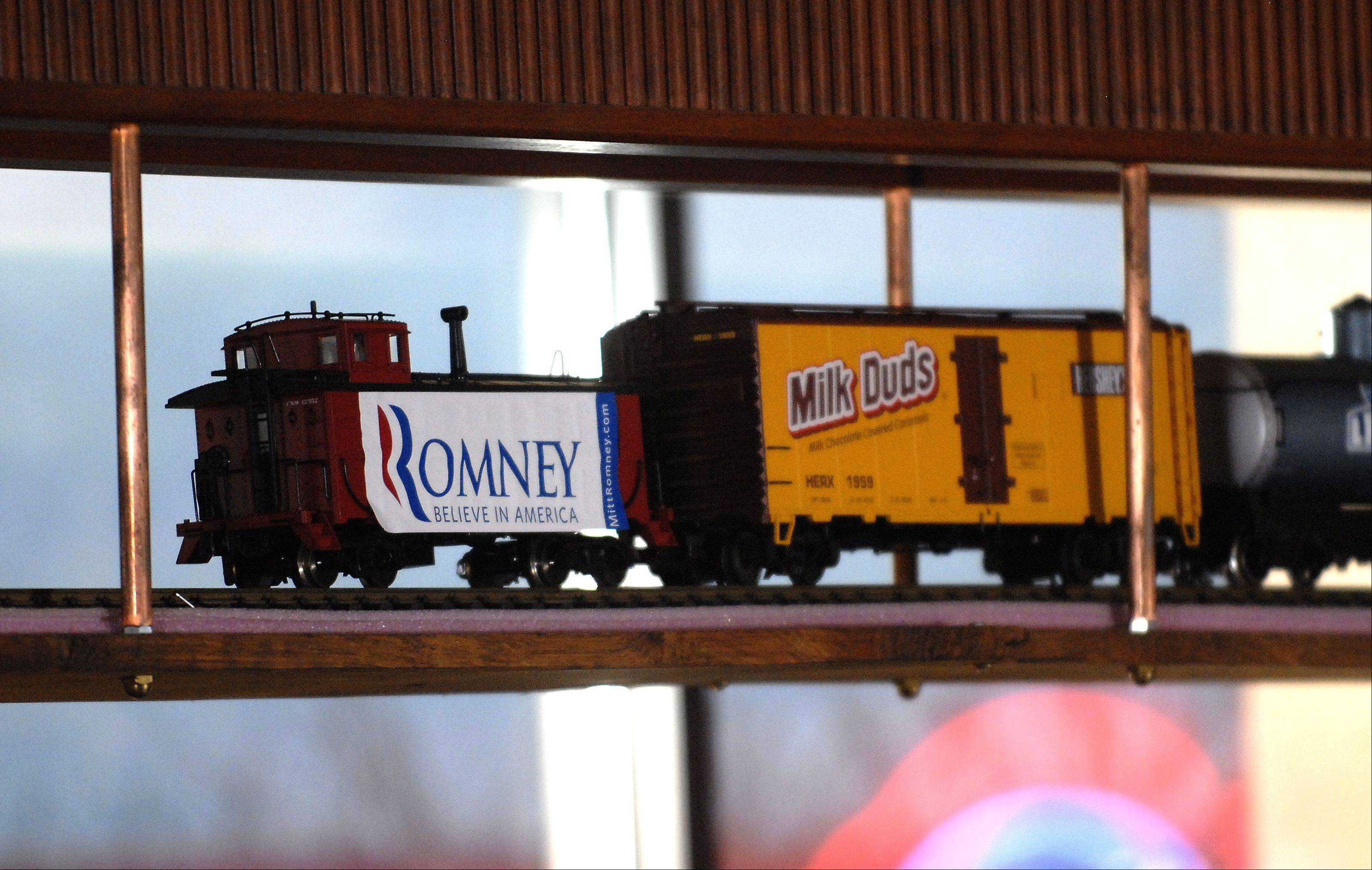 A train that circles the dining room in Pancakes Eggcetera bears a Mitt Romney sign Friday morning in Rosemont.