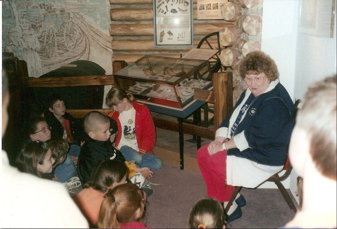 The late Marilyn Robinson speaks to Batavia third-graders studying local history at the Depot Museum in Batavia.