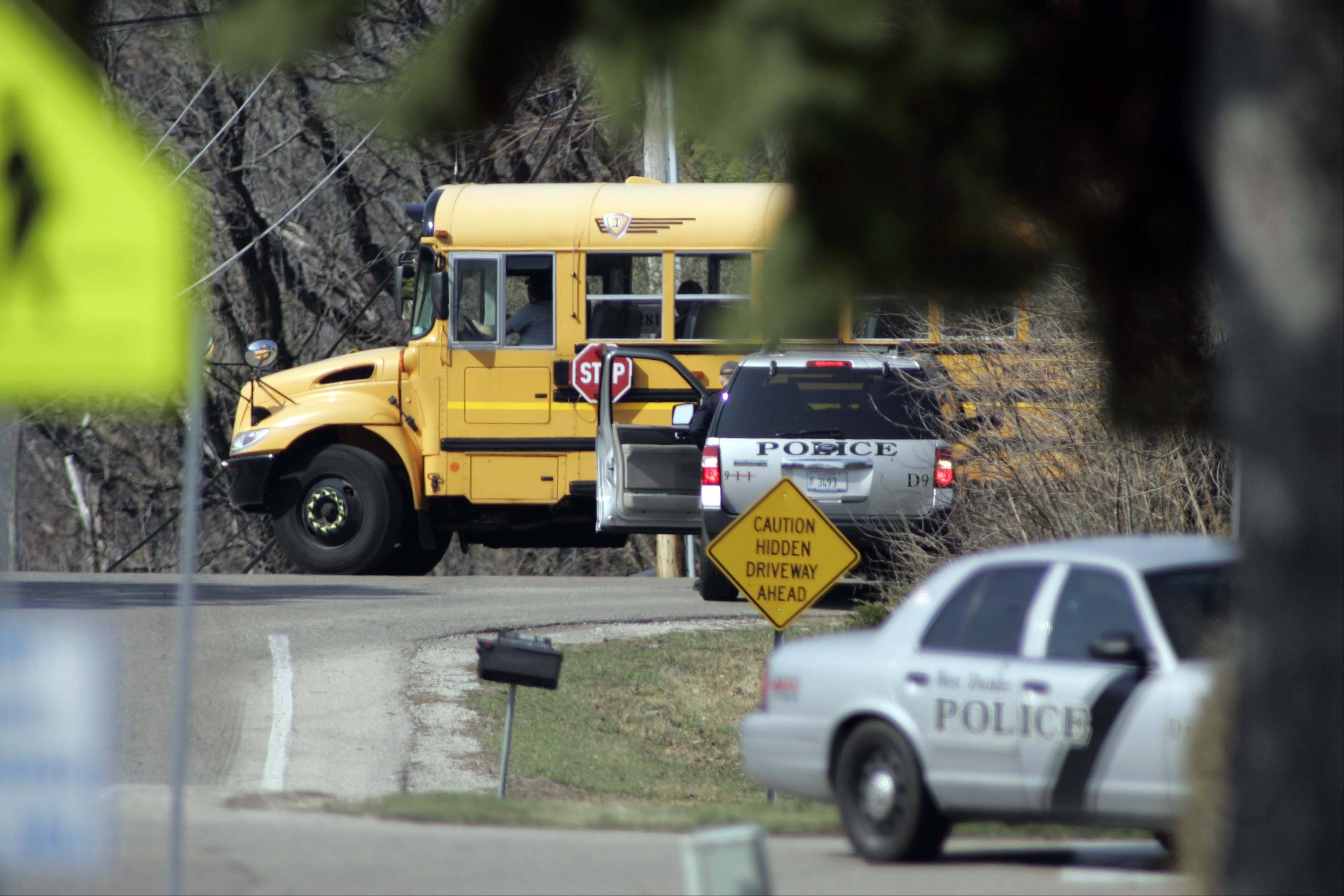 A school bus leaves Dundee-Crown High School, which was put on lockdown Friday morning after a threat of a shooting at the school. The lockdown was lifted when the student believed to have made the threat was determined to be off-campus.
