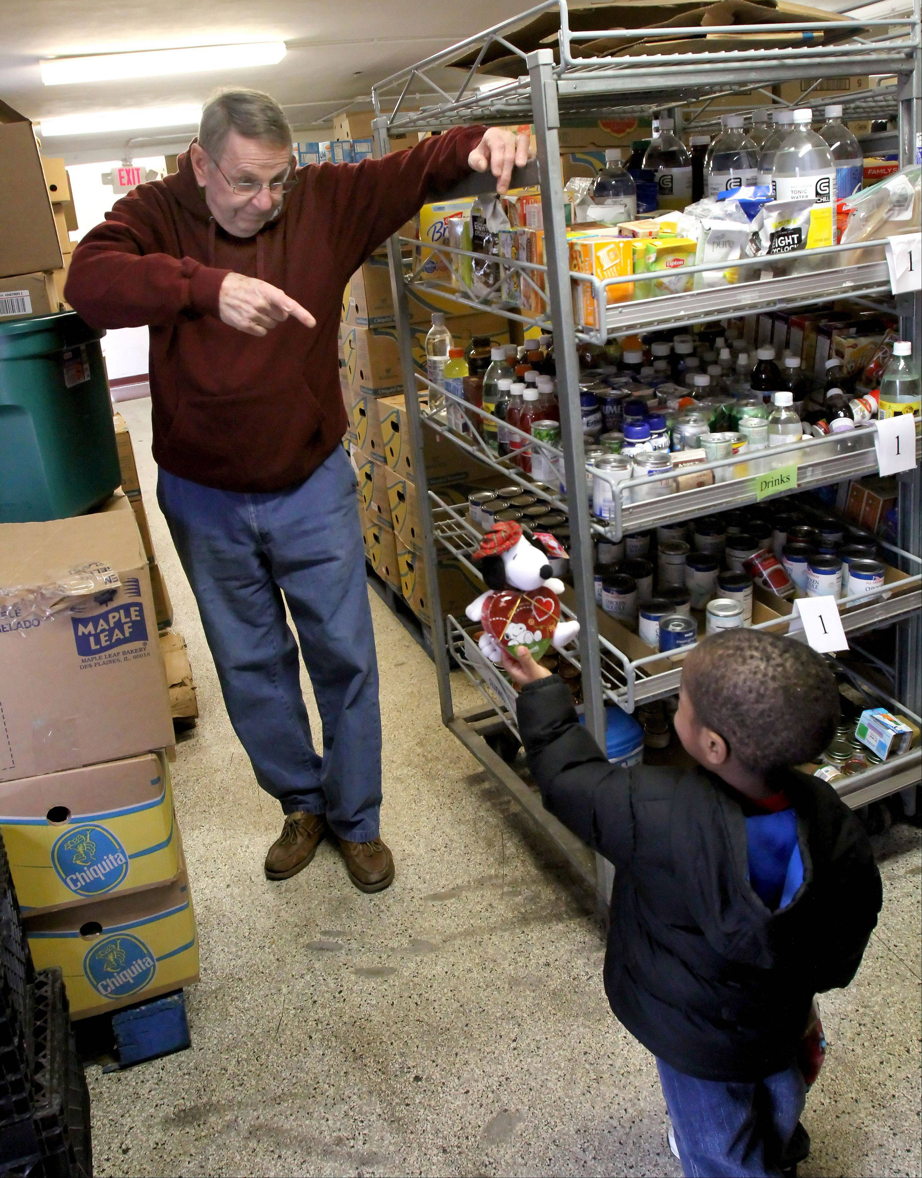 Don McGowan chats for a moment with 2-year-old Yusef Musa at the People's Resource Center.