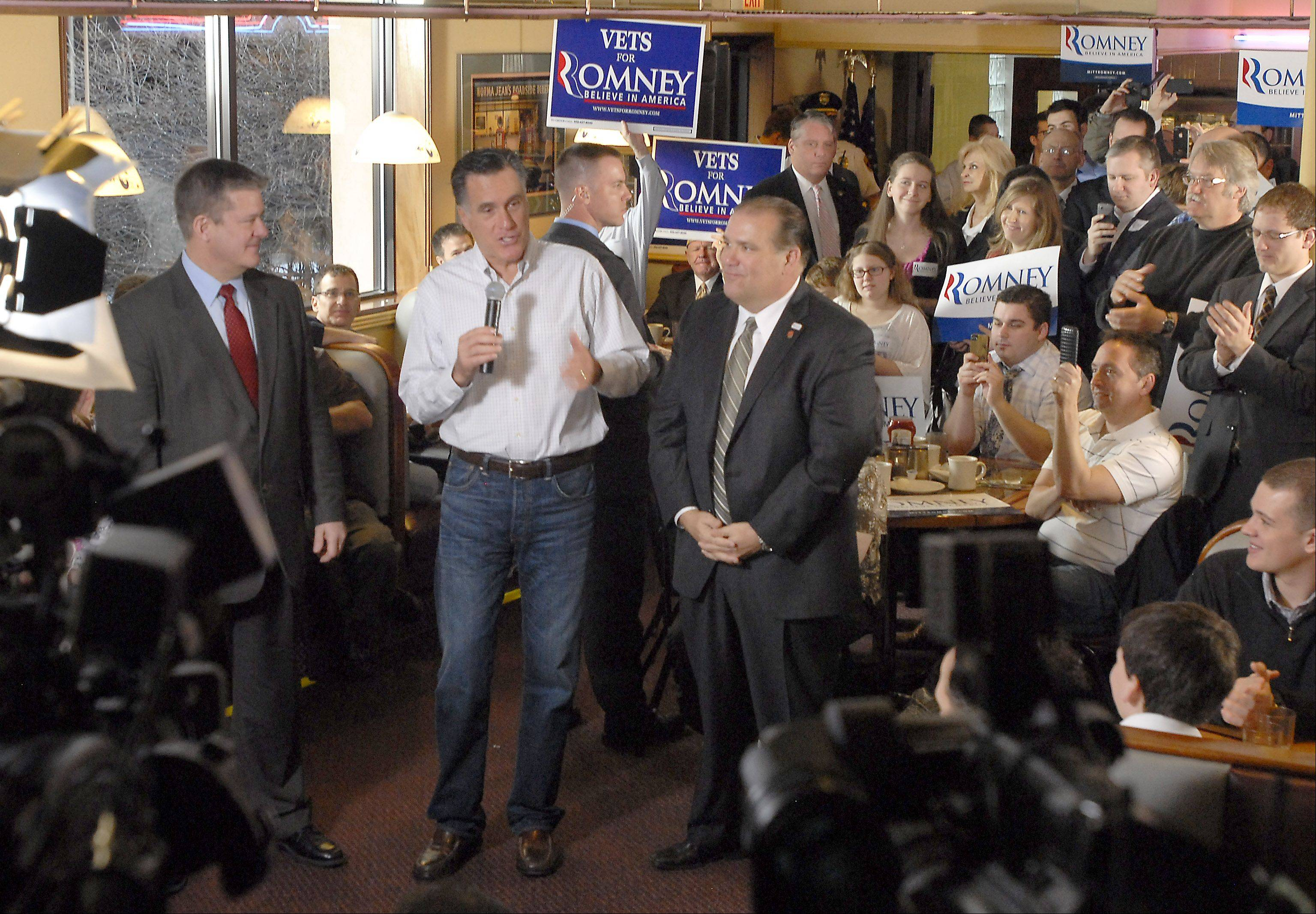 Republican presidential candidate Mitt Romney, center, is joined by Illinois State Treasurer Dan Rutherford, left, and Rosemont Mayor Bradley Stephens early Friday morning at a restaurant in Rosemont.
