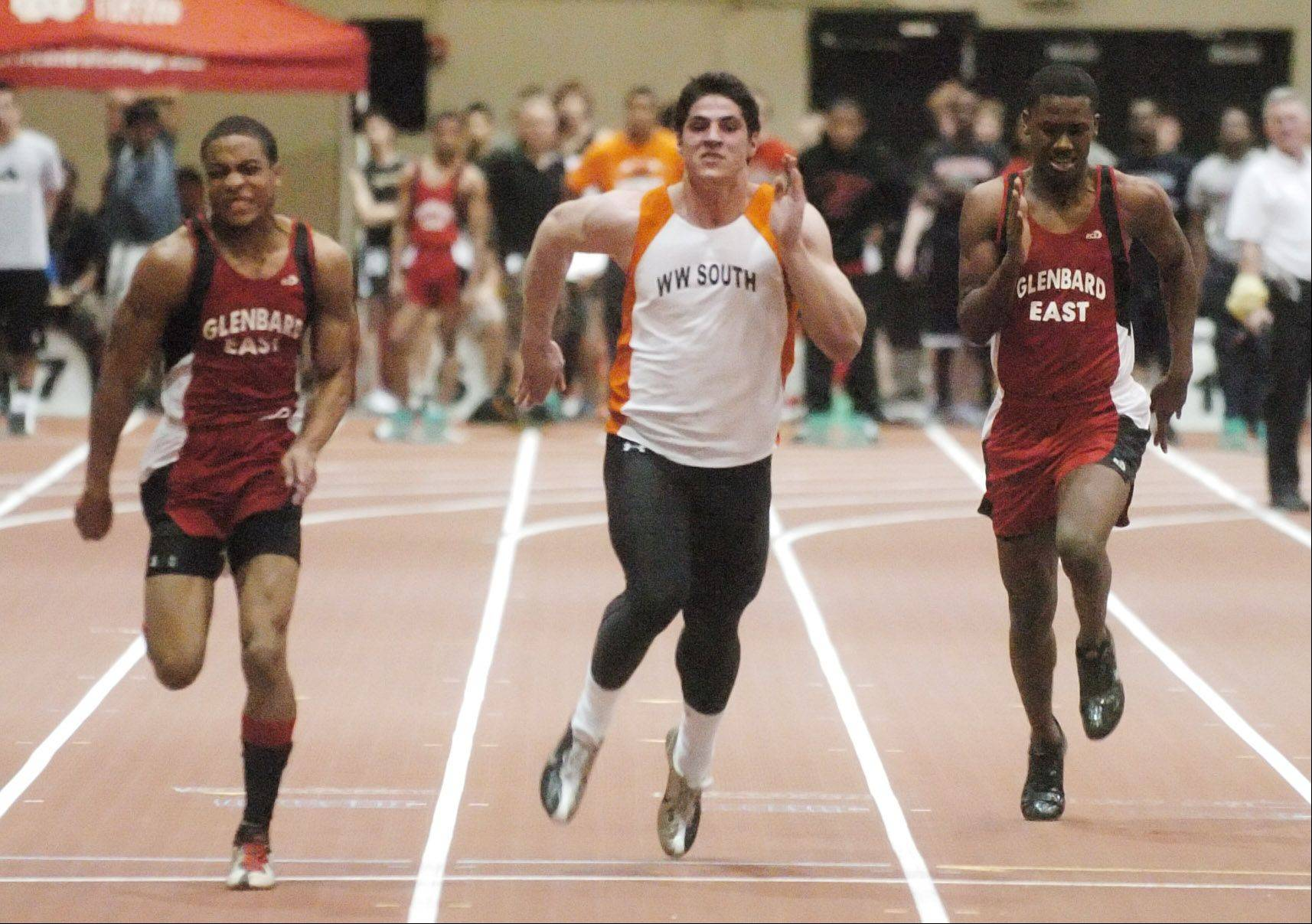 Markel Brackett,left, of Glenbard East, Dan Vitale of Wheaton Warrenville south, and Antwon James of Glenbard East take part in the 55 meter dash during the DuPage Valley Conference indoor boys track meet in Naperville Friday.
