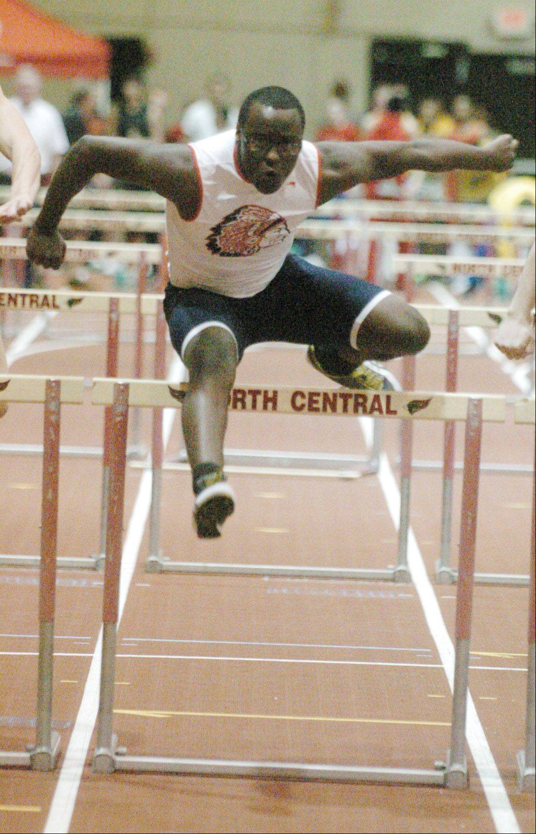 "Seven Taylor of West Aurora High School in the 55 meter high hurdles during the DuPage Valley Conference indoor boys track meet in Naperville Friday. (The program says ""Seven"")"