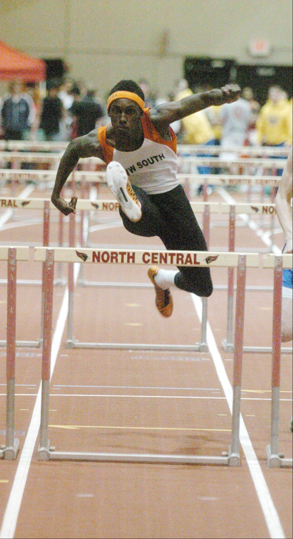 Phabian Clark of Wheaton Warrenville South in the 55 high hurdles during the DuPage Valley Conference indoor boys track meet in Naperville Friday.
