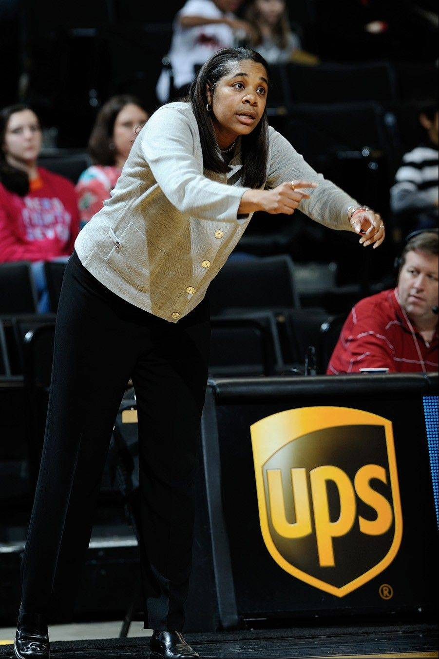 After 14 wins in her first year as Davidson's head coach, former NU basketball star Michele Savage led her team to a conference title and NIT berth with 22 wins in her second year at the helm.