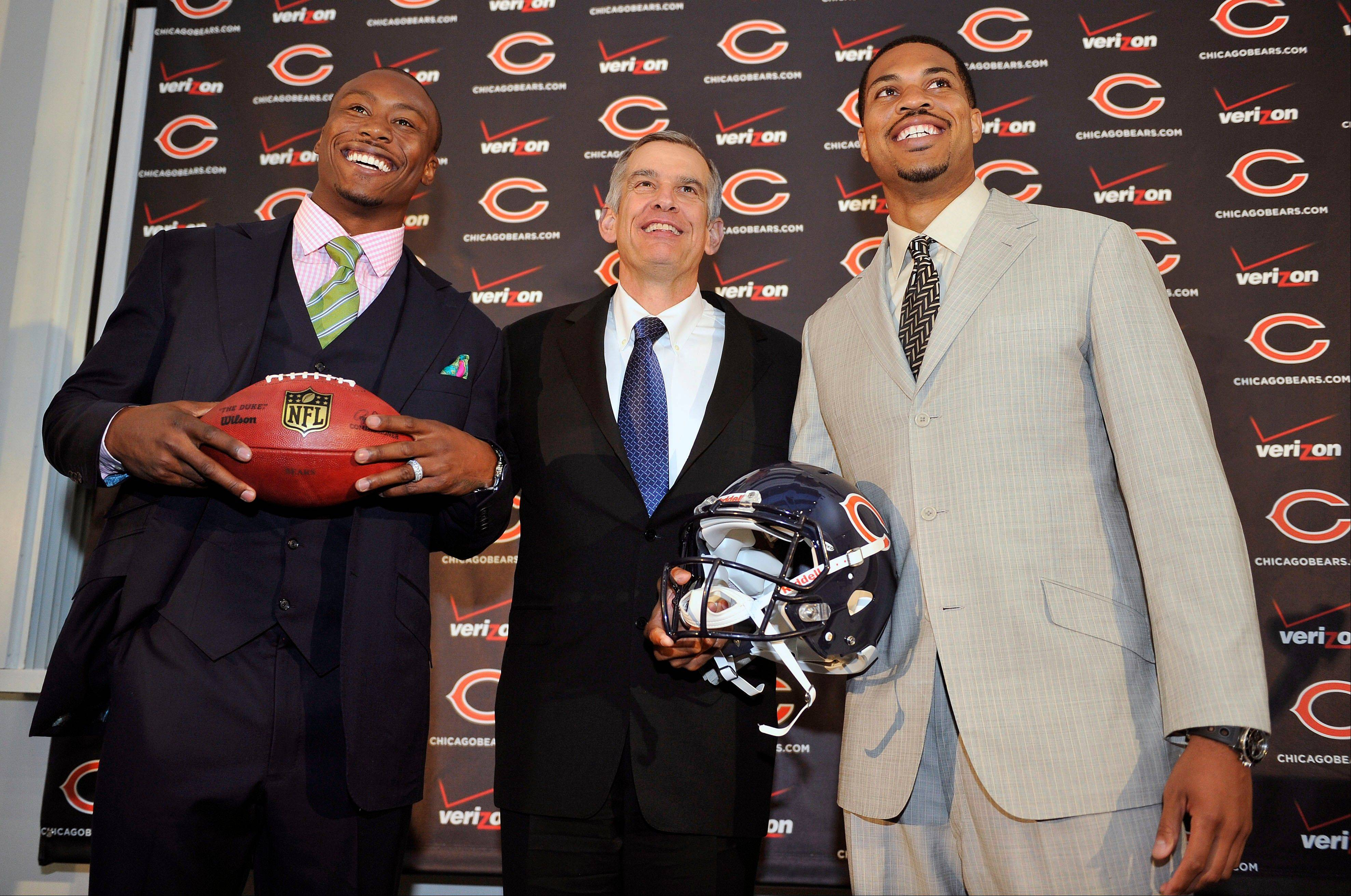 The two newest members of the Chicago Bears, wide receiver Brandon Marshall, left, and quarterback Jason Campbell, are welcomed to Chicago by general manager Phil Emery, center, during a news conference Friday.