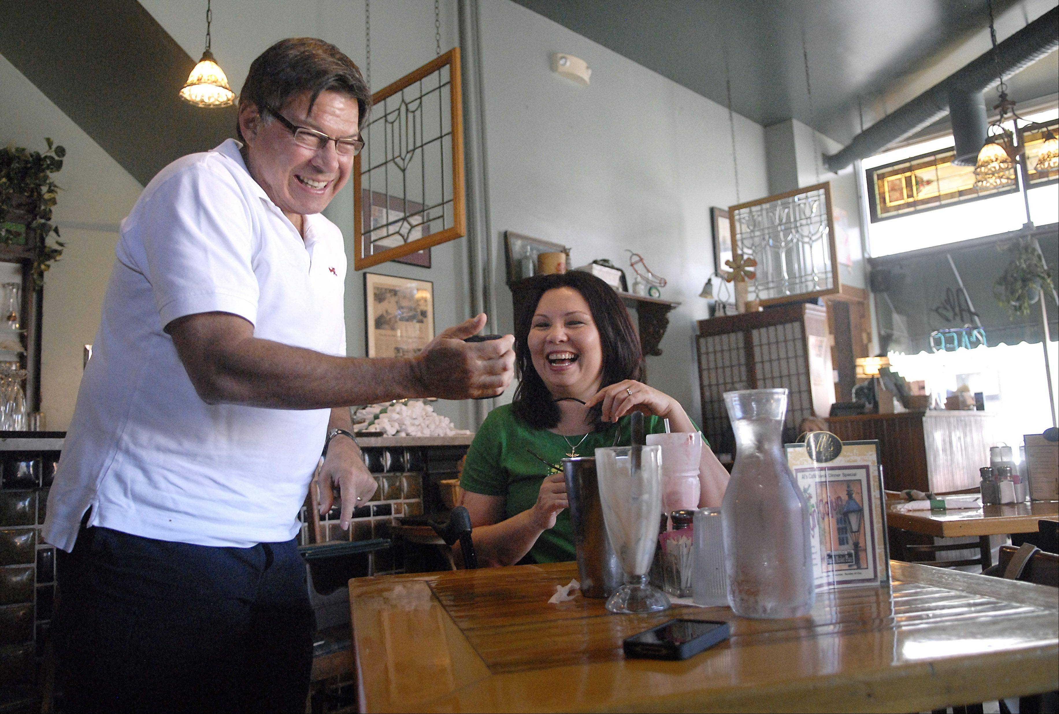 Lance Rodgers of Barrington shares a laugh about a text with Democratic 8th District Congressional candidate Tammy Duckworth Saturday at Al's Cafe in Elgin.
