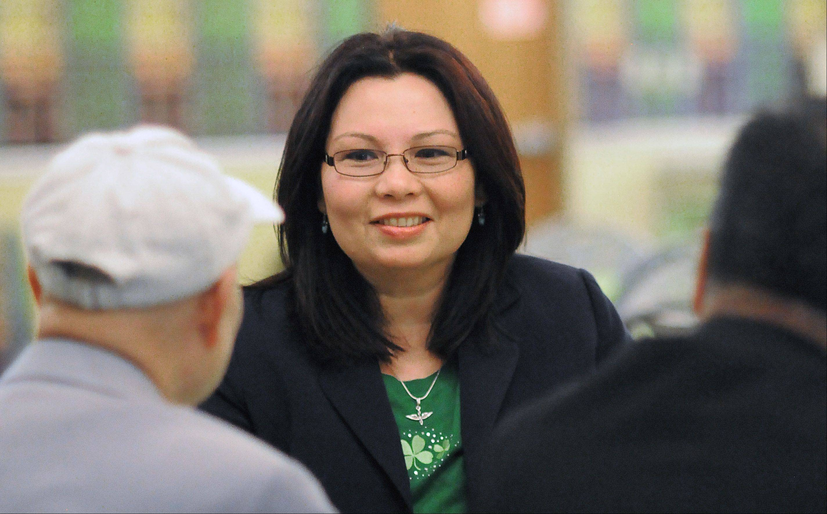 Tammy Duckworth, 8th Congressional District Democratic candidate, visits Saysana Songvilay of Elgin and other Laotian community leaders Saturday in Elgin.