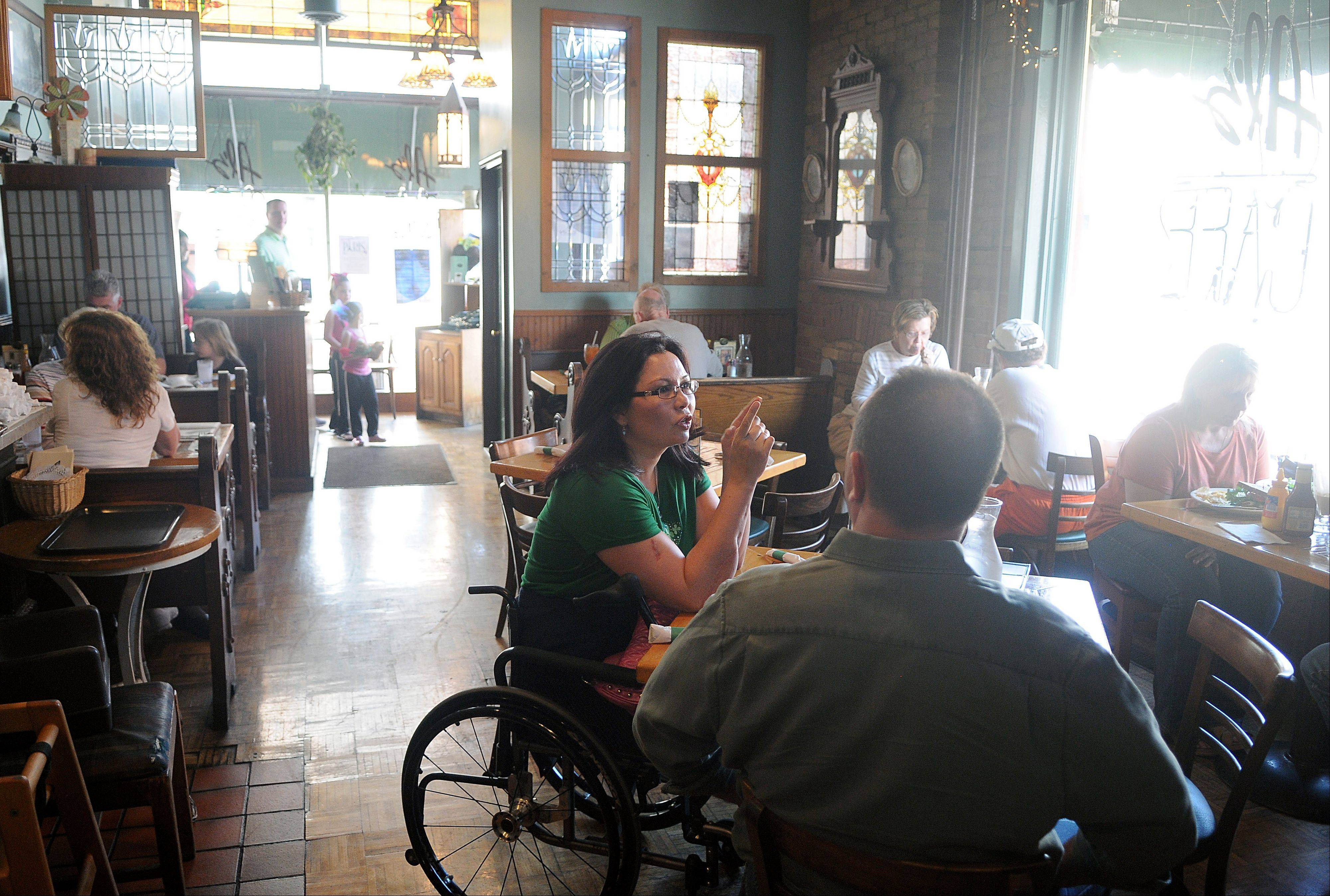 Tammy Duckworth, 8th Congressional District Democratic candidate, visited Al's Cafe in Elgin on Saturday with her husband, Bryan.