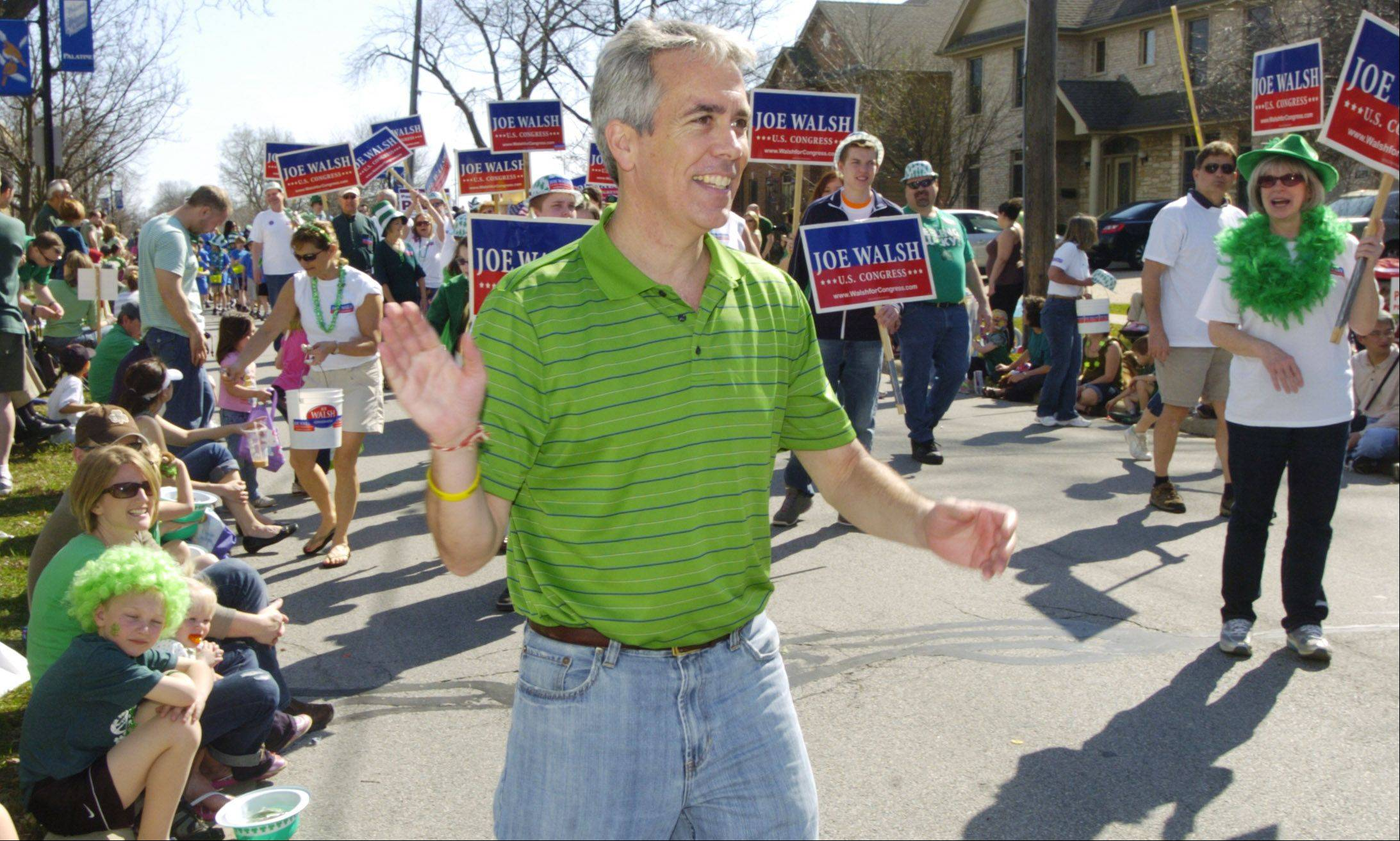 Republican Congressman Joe Walsh, the 8th District incumbent, waves to St. Patrick's Day parade onlookers Saturday in Palatine.