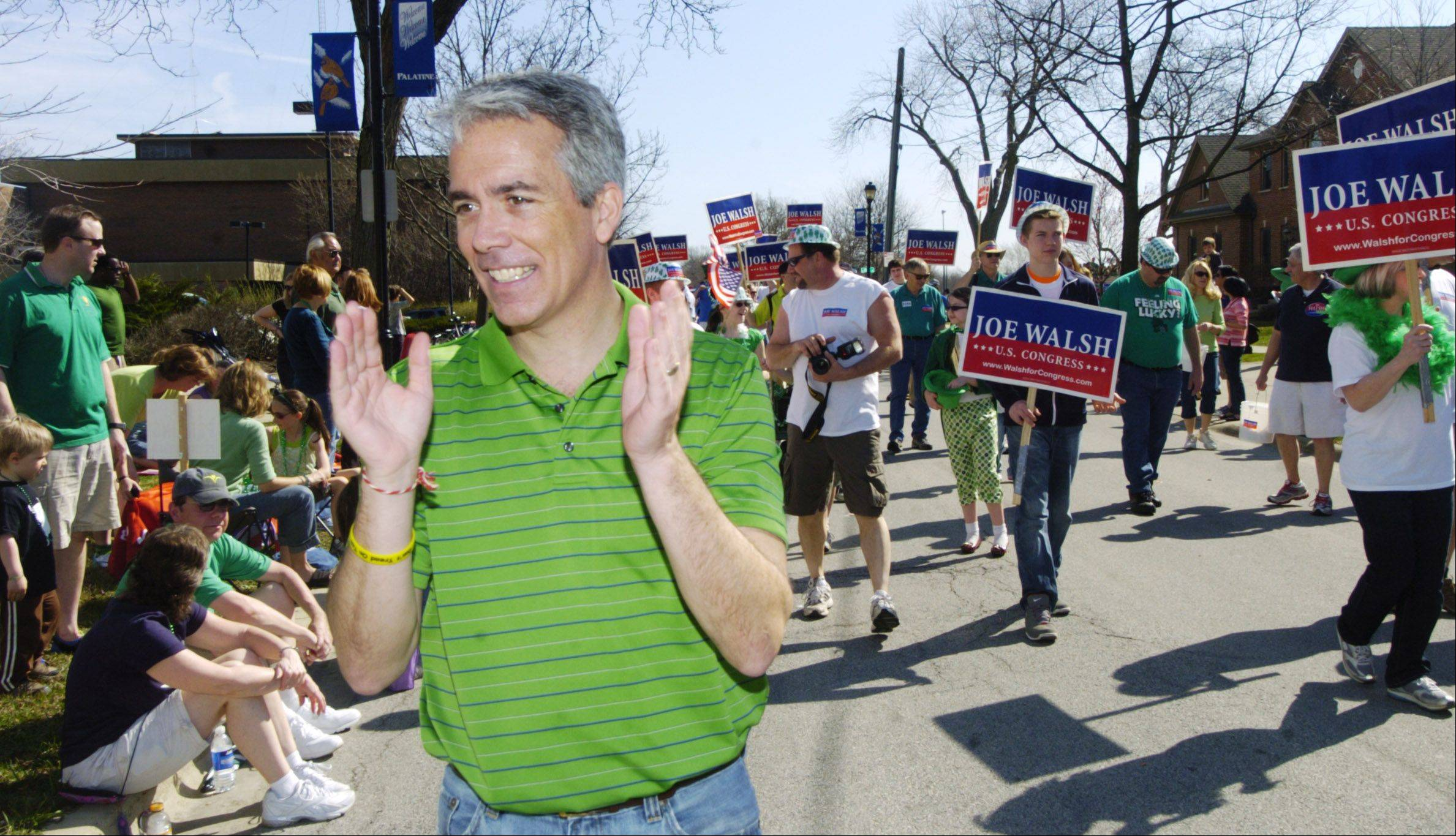 Republican Congressman Joe Walsh, the 8th District incumbent, greets members of the crowd lining Wood Street on Saturday during the Palatine St. Patrick's Day Parade.
