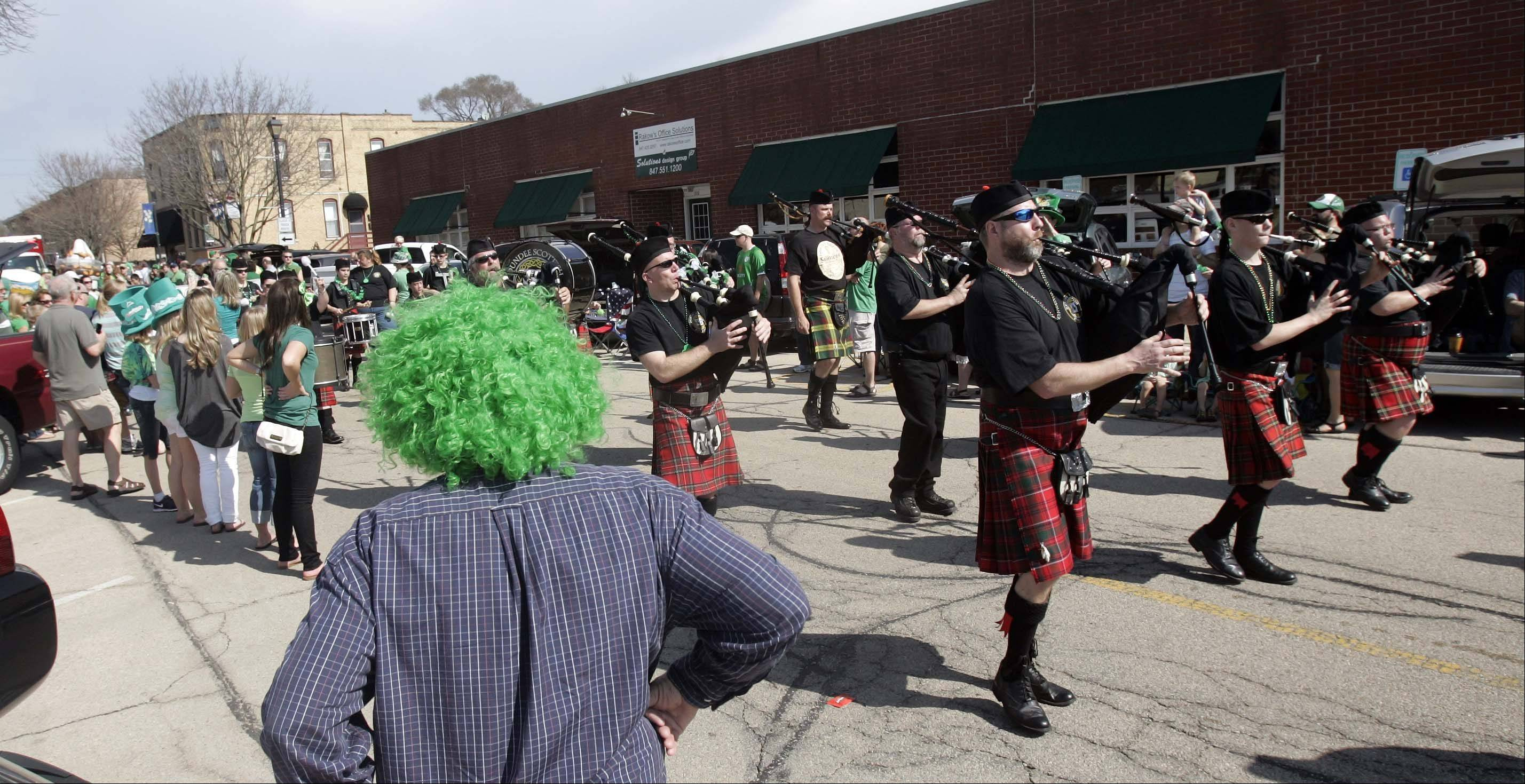 The Dundee Scottish Pipe Band marches down the Thom McNamee Memorial St. Patrick's Day Parade route in East Dundee March 17, 2012.