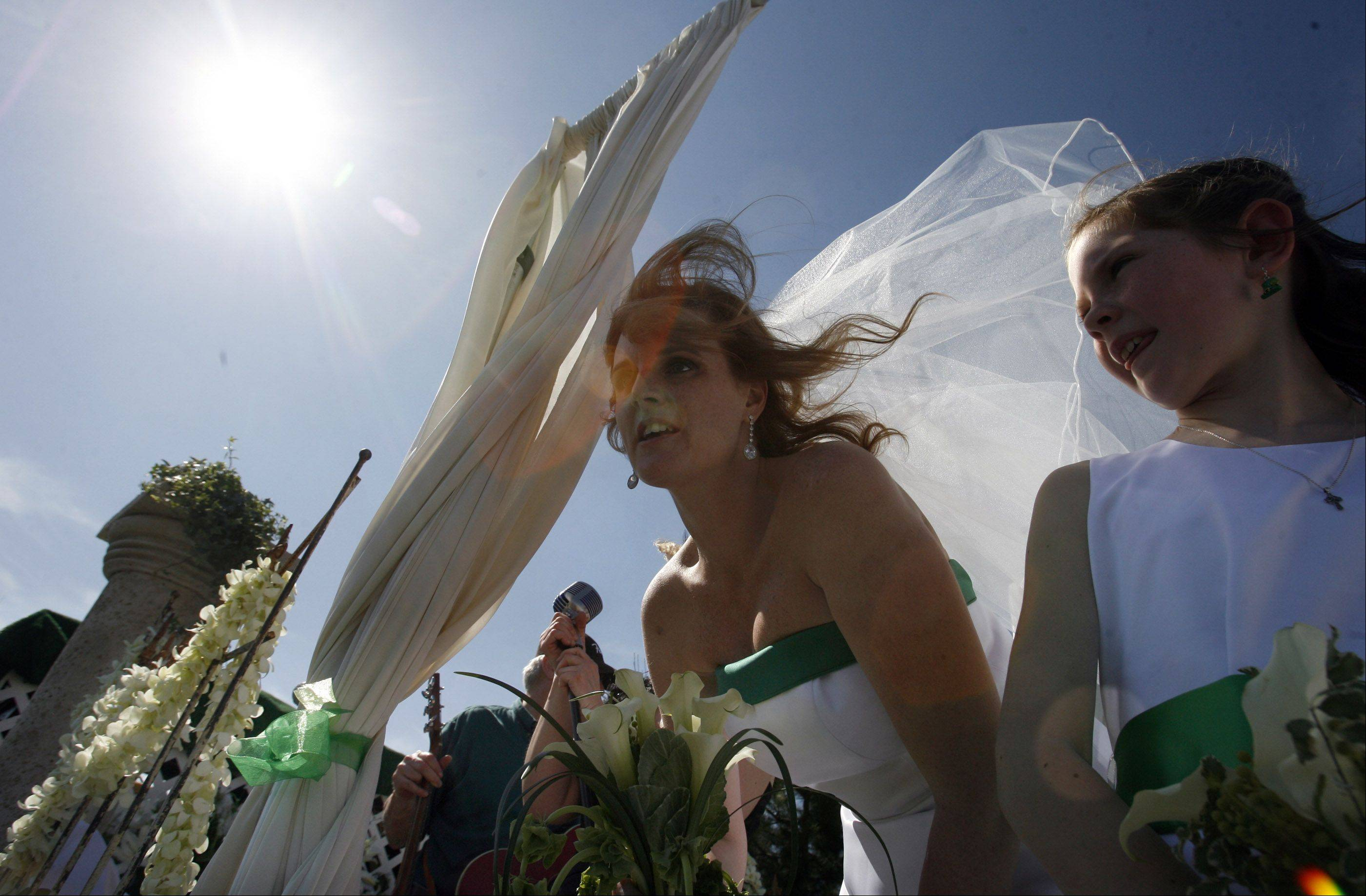 Tara Teschky vail blows in the wind while riding on her wedding float during the Lake Villa St. Patrick's Day parade on Saturday, March 17th.