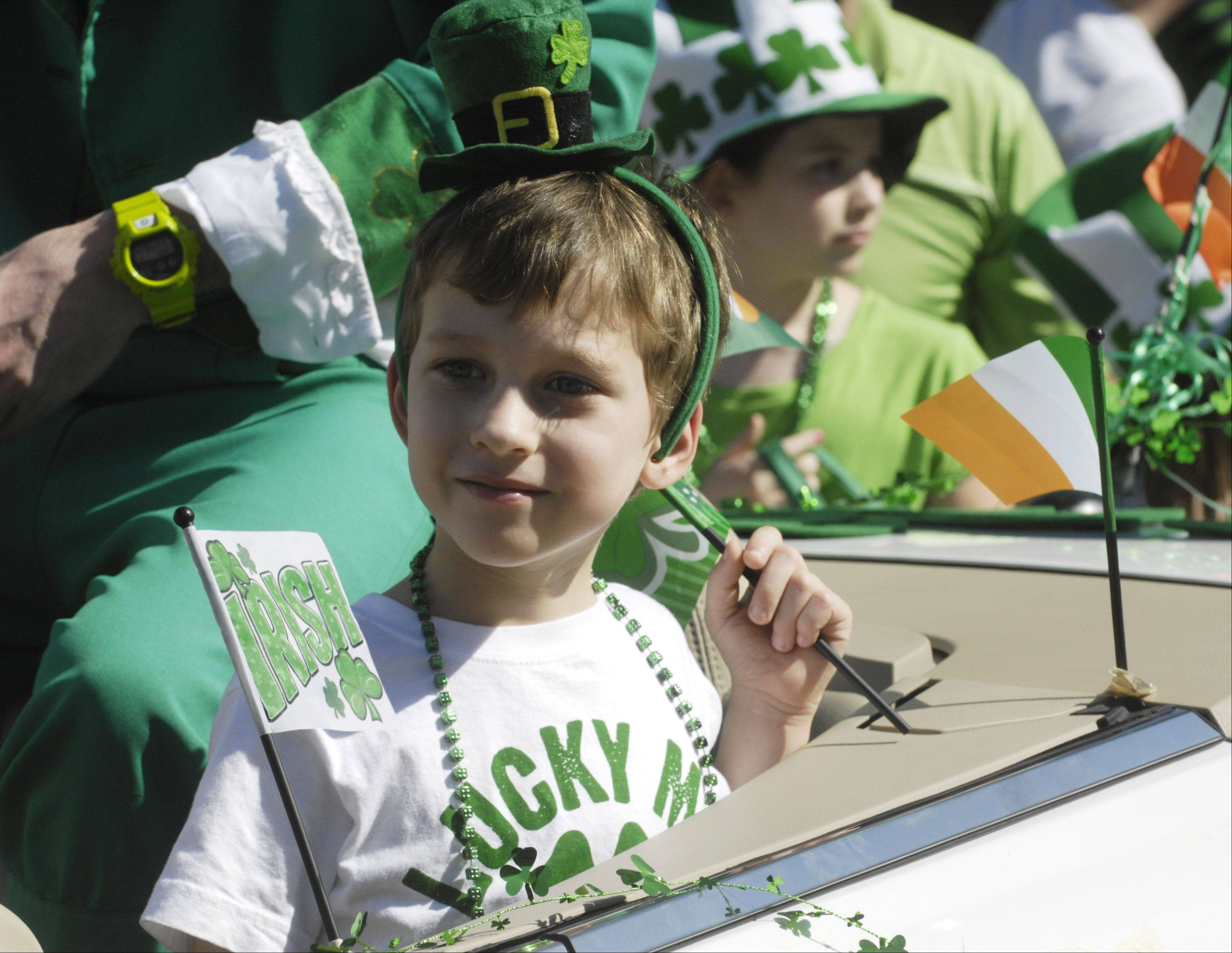 Emmit Hannon, 6, of Palatine rides in the Palatine St. Patrick's Day Parade Saturday.