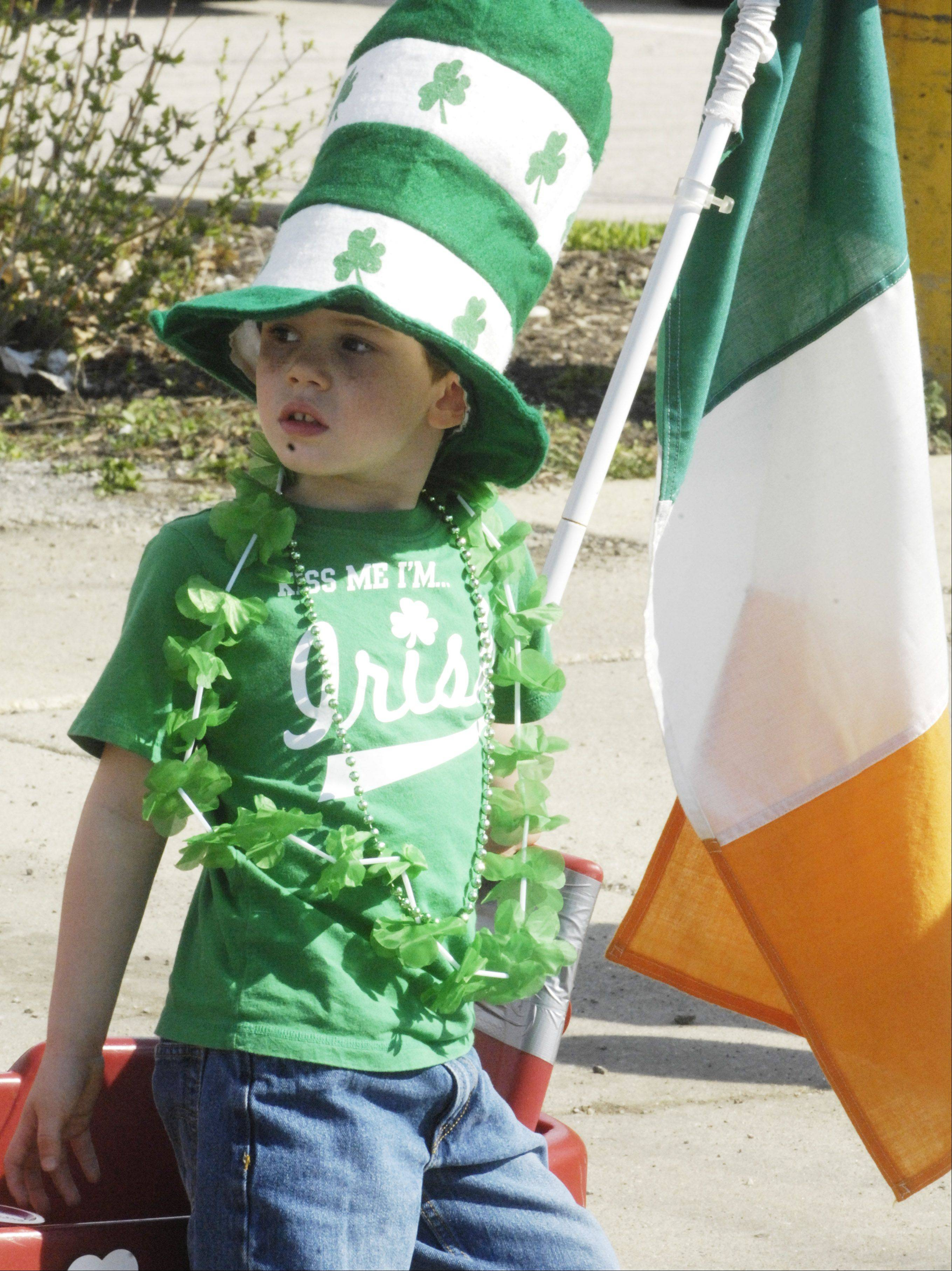 Jack Wrigley Sloan, 5, of Palatine waits for the start of the Palatine St. Patrick's Day Parade Saturday.