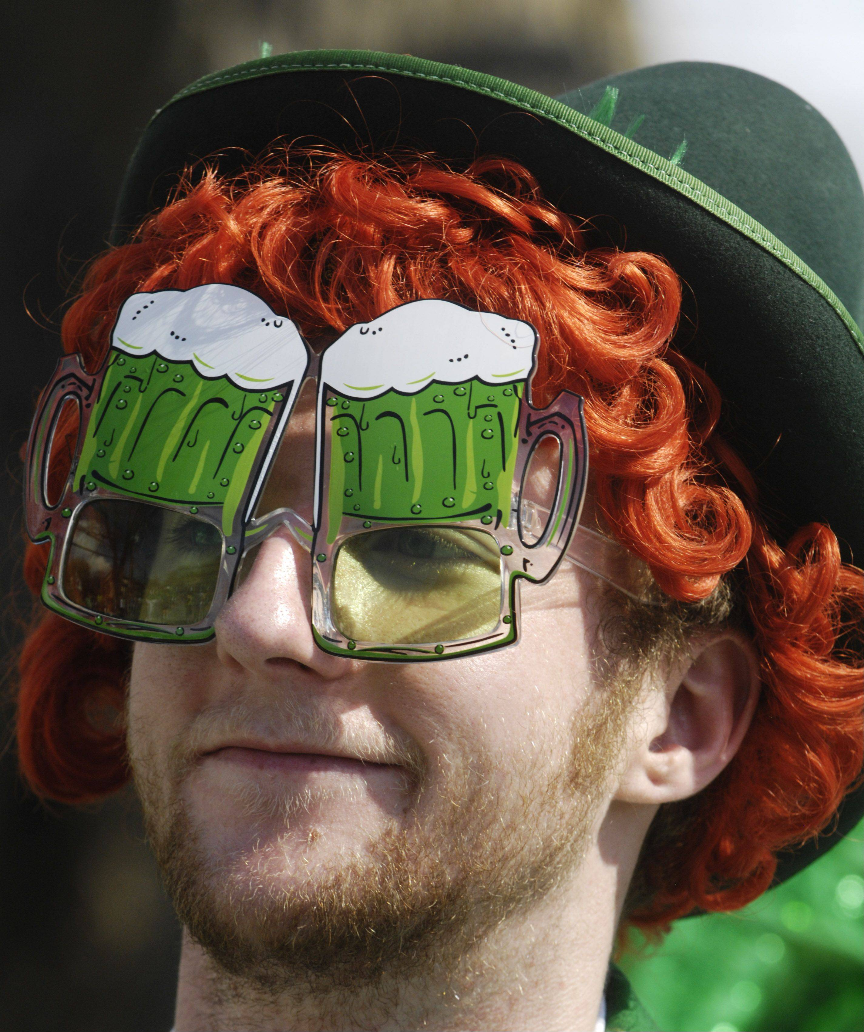 Ethan Simpson of Park Ridge rides in the Bauer's Brauhaus car during the Palatine St. Patrick's Day Parade Saturday.