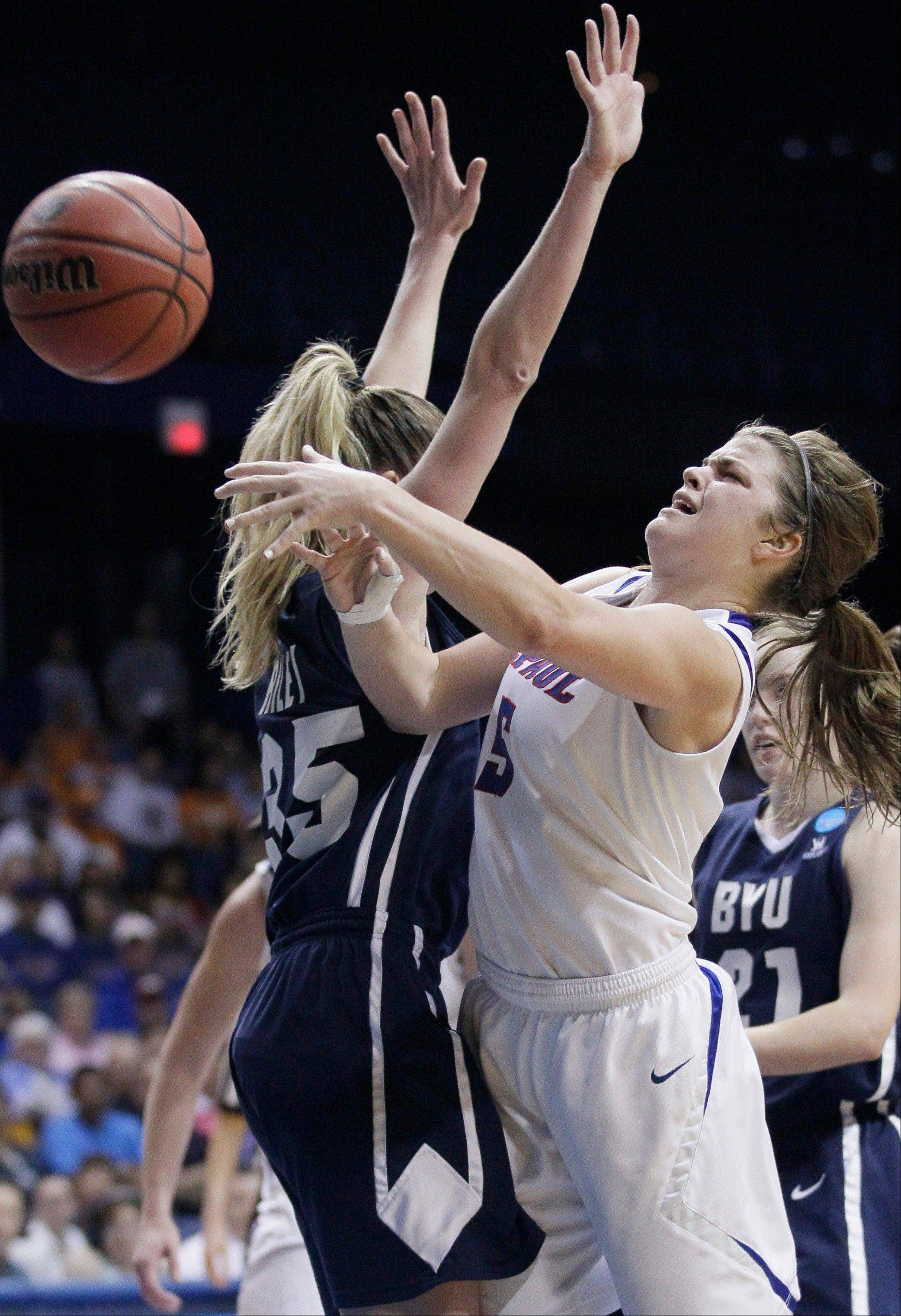DePaul guard Anna Martin (5) shoots over BYU center Kristen Riley (35) during the second half of an NCAA Tournament first-round women's college basketball game in Rosemont on Saturday.