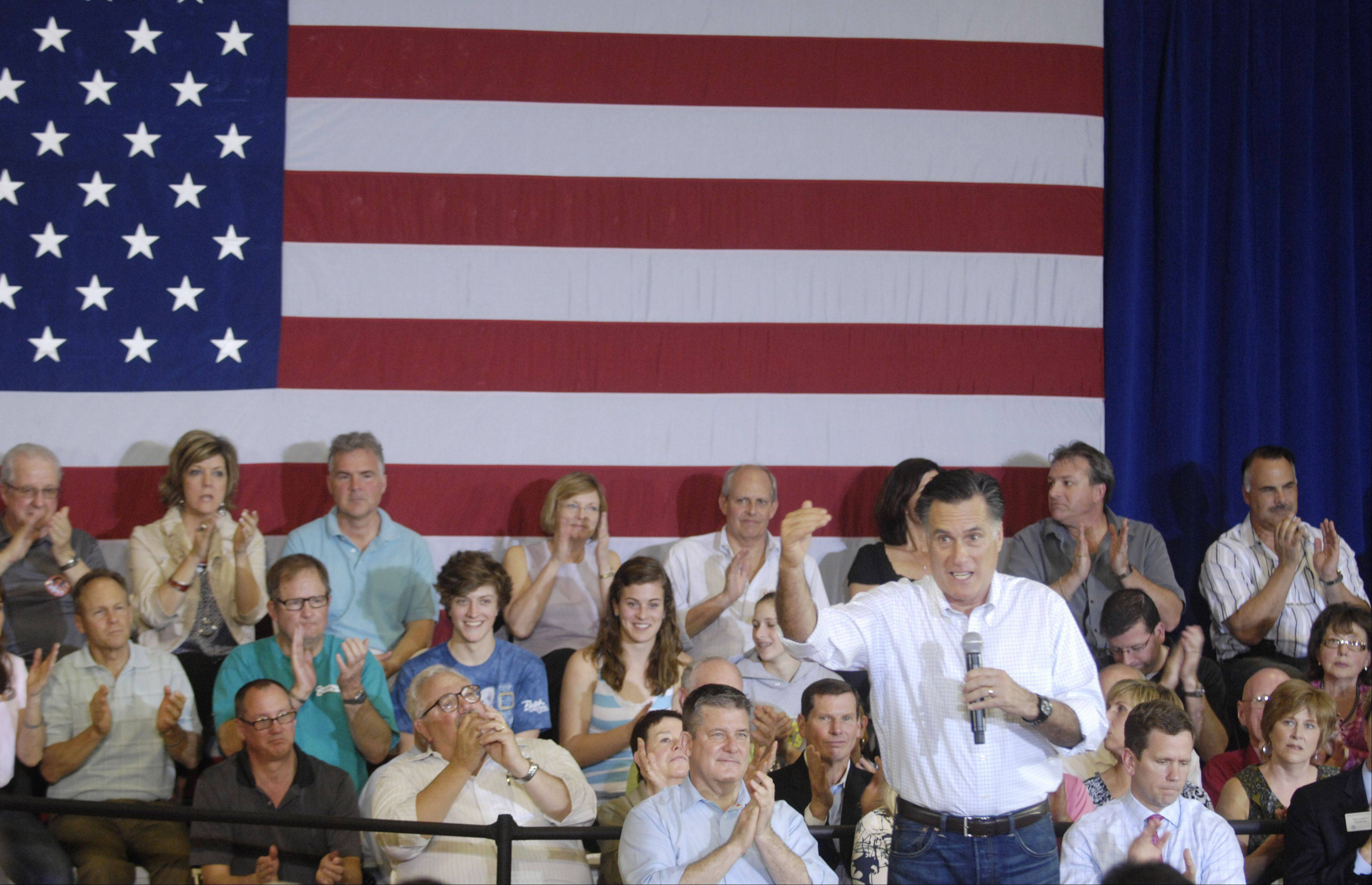 Republican presidential candidate Mitt Romney holds a town-hall meeting at the Sullivan Community Center Gymnasium in Vernon Hills Sunday.