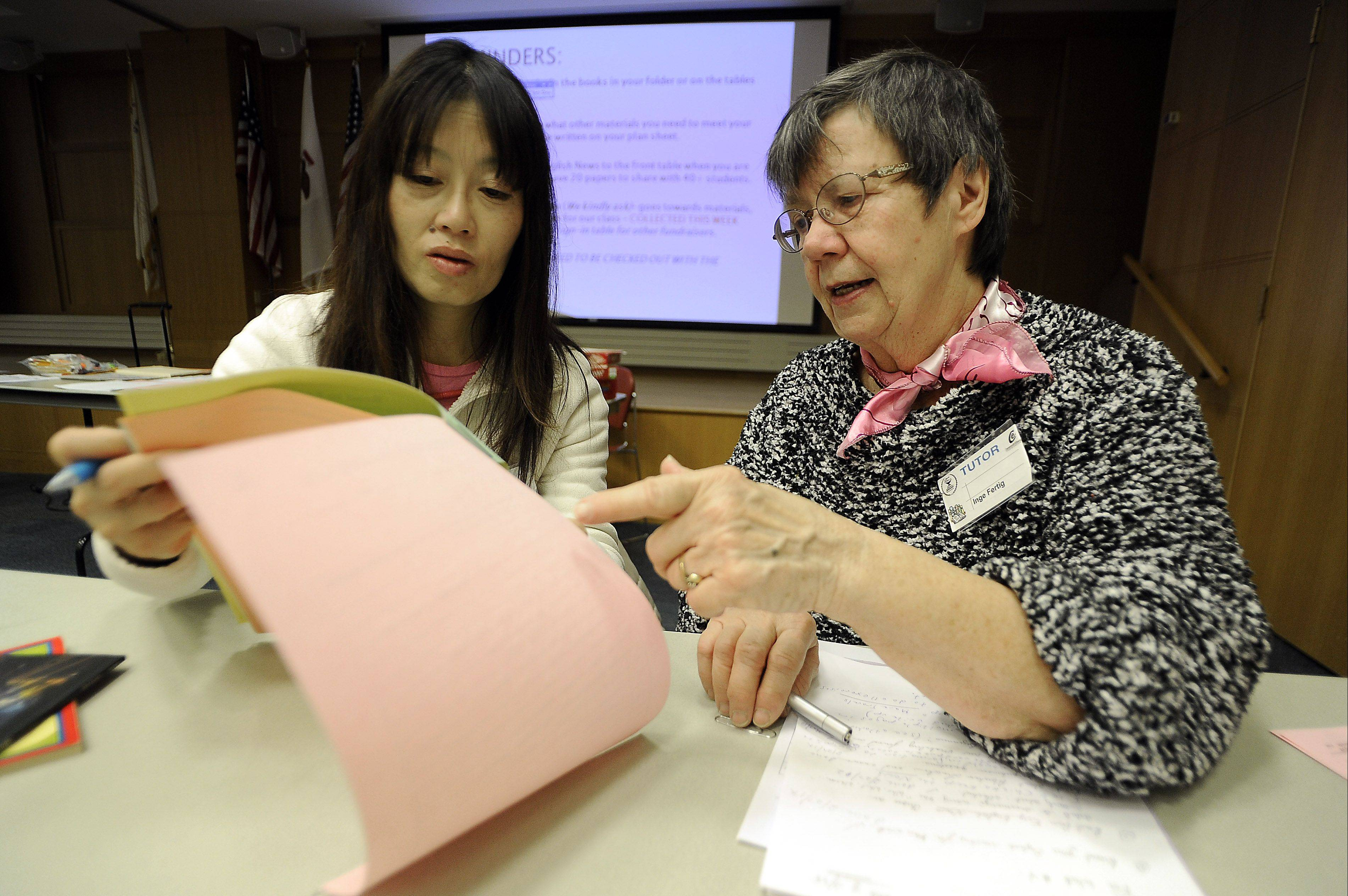 Chieko Katsuma of Vernon Hills works with tutor Inge Fertig of Arlington Heights at the Arlington Heights Memorial Library for the District 214 Read to Learn program.