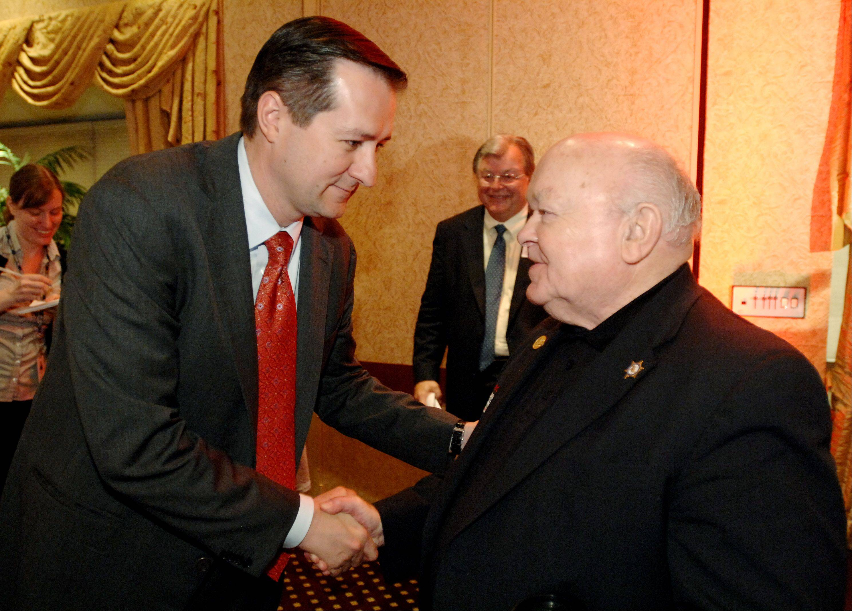 Chicago Cubs Chairman Tom Ricketts speaks with Mayor George Pradel of Naperville during a Naperville Area Chamber of Commerce lunch Monday at the Lisle Hilton.