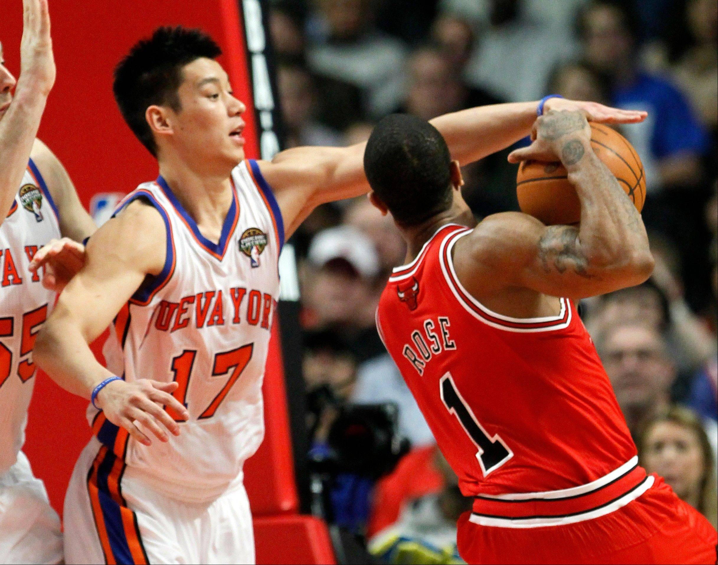 New York Knicks guard Jeremy Lin tries to block the shot of Bulls guard Derrick Rose in a game last week.