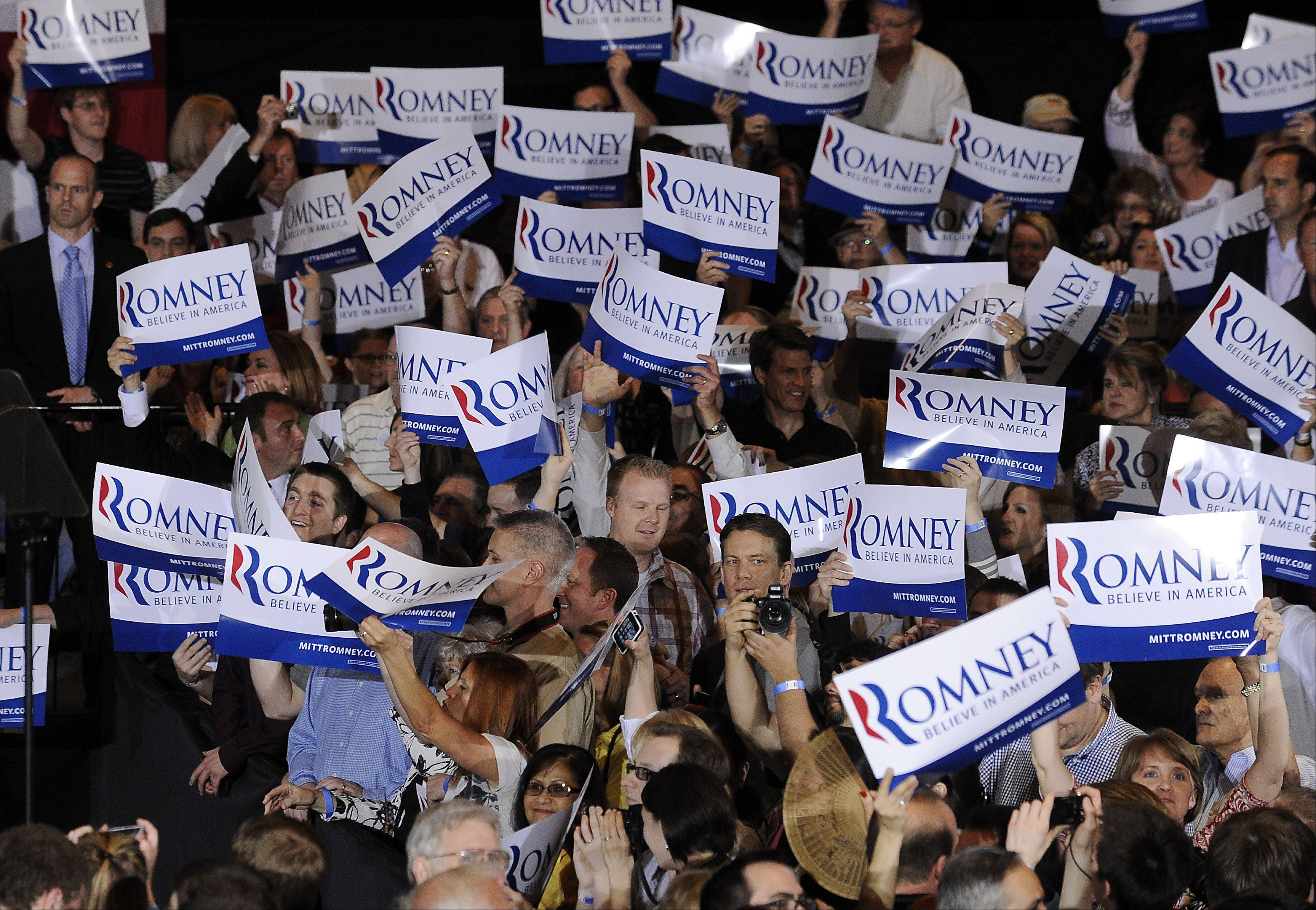 Mark Welsh/mwelsh@dailyherald.com Mitt Romney's supporters get ready to greet him after he wins the Illinois Primary.