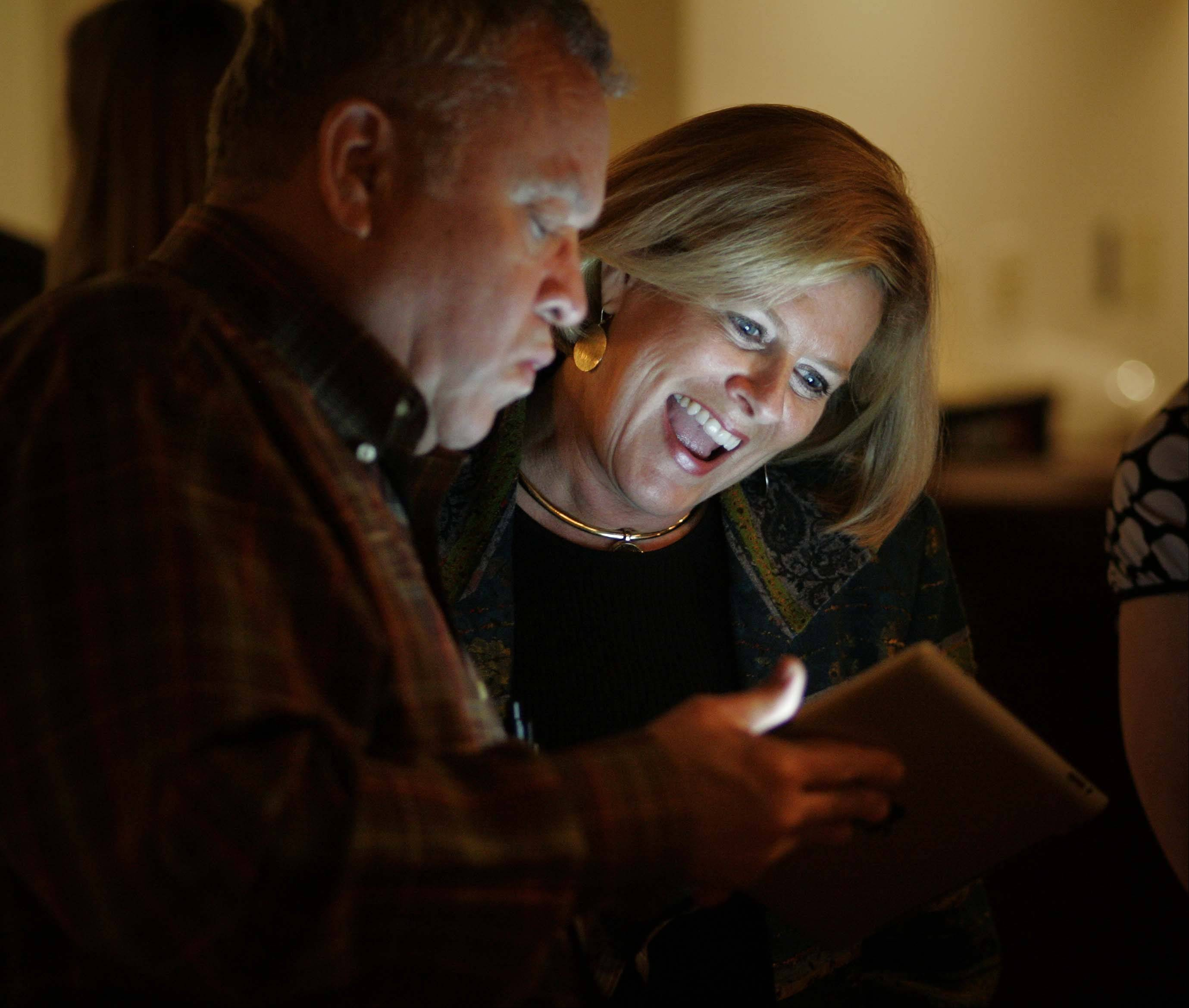 Andy Raucci of Chicago shows Karen McConnaughay results in the Republican primary Tuesday night for the 33rd Senate District at Emmett's in West Dundee.