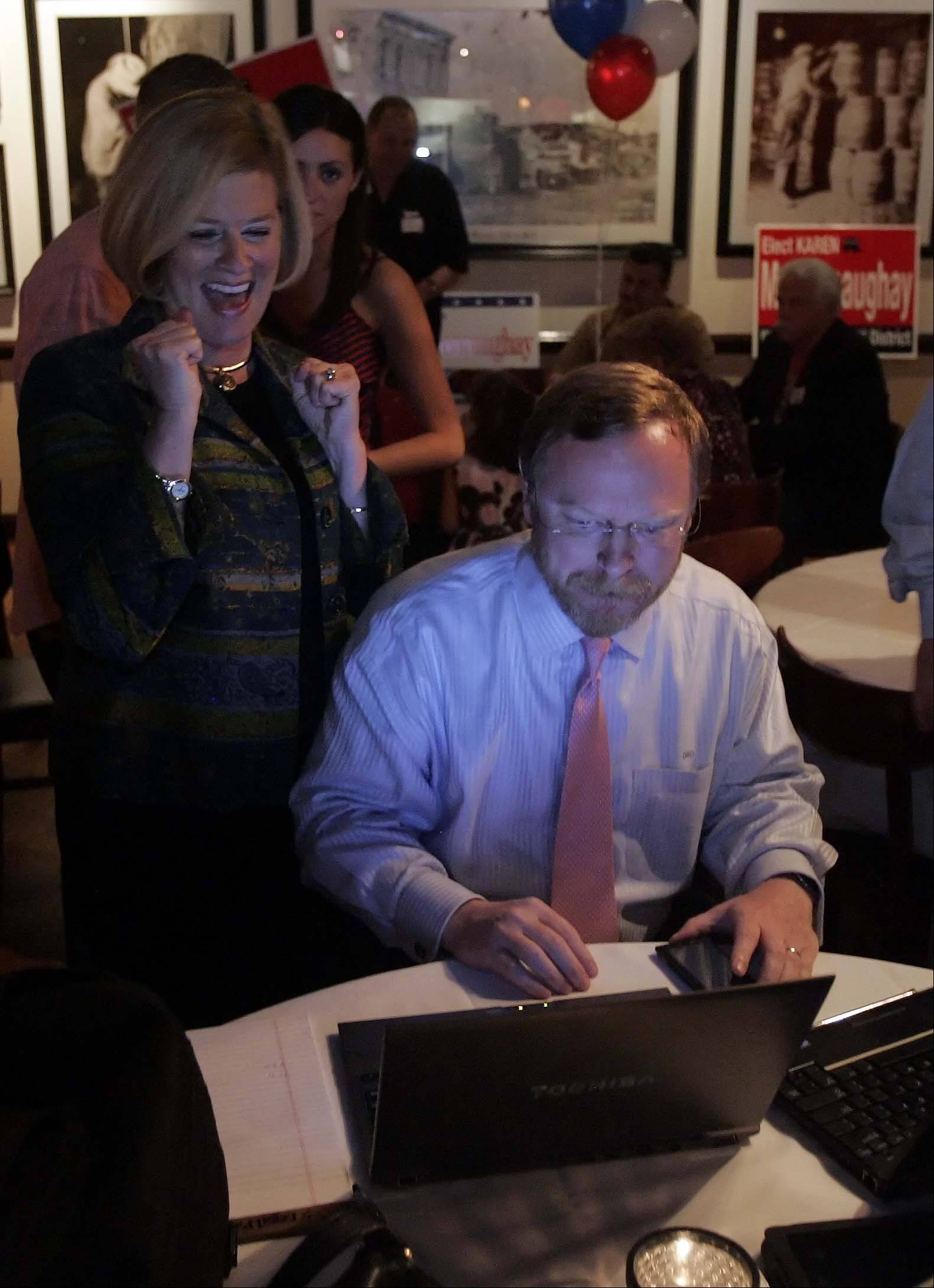 BRIAN HILL/bhill@dailyherald.comKaren McConnaughay watches results in the Republican primary for the 33rd Senate District at Emmetts in West Dundee March 20, 2012. Media liaison Doug O'Brien works the computers.