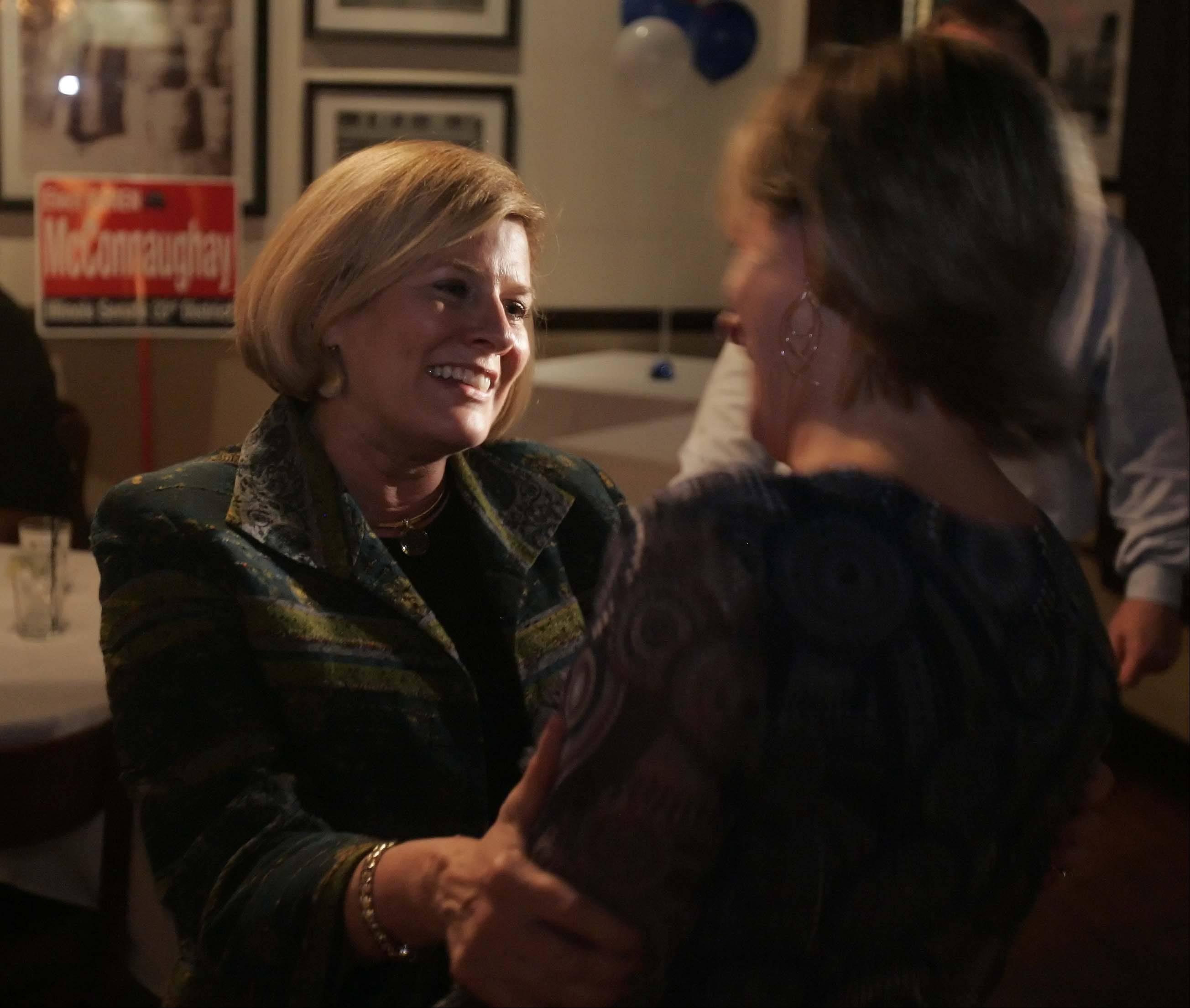 Karen McConnaughay talks to county board candidate Maggie Auger as results pour in for the Republican primary for the 33rd Senate District at Emmett's in West Dundee.