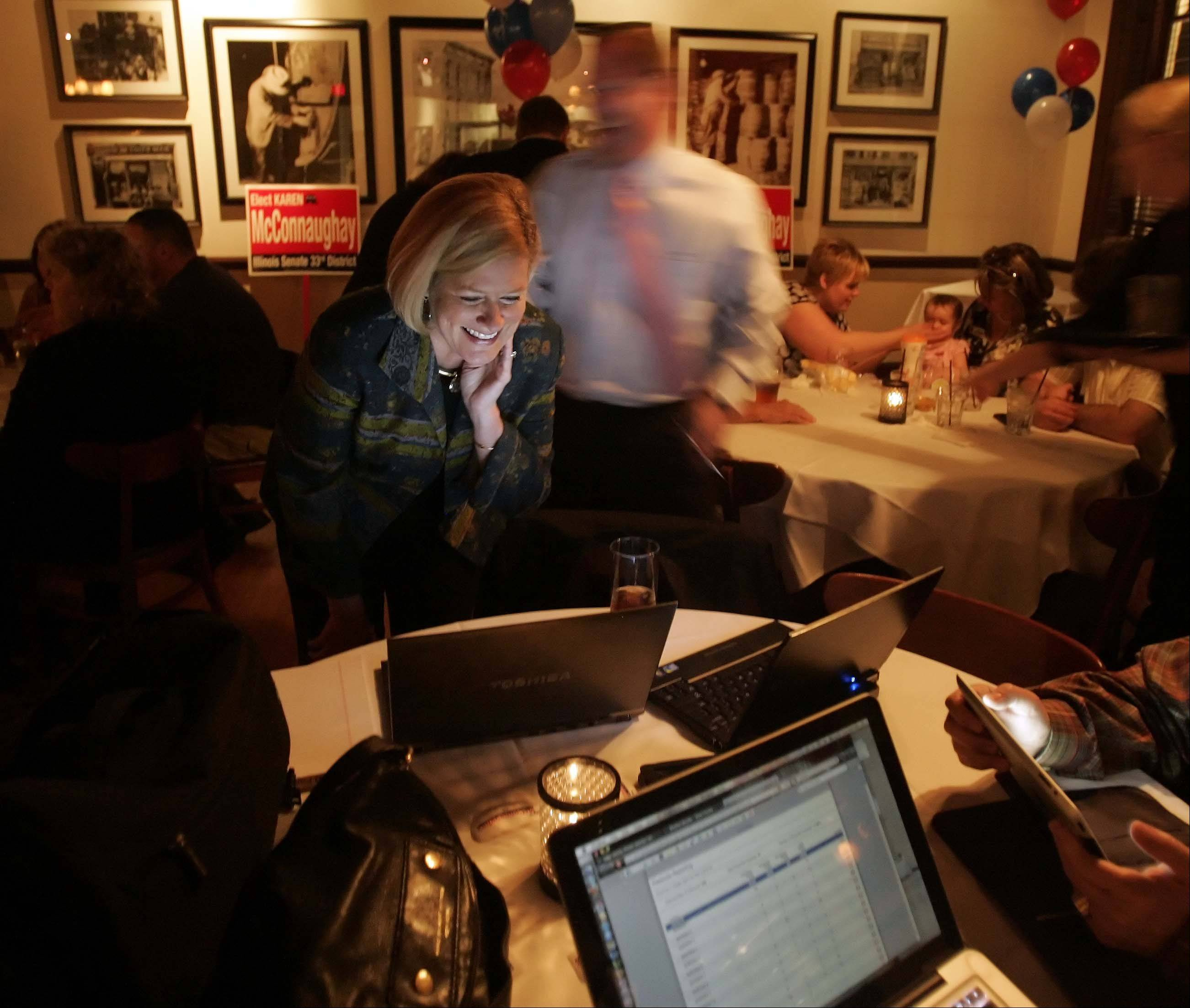 Karen McConnaughay watches results in the Republican primary for the 33rd Senate District at Emmett's in West Dundee.
