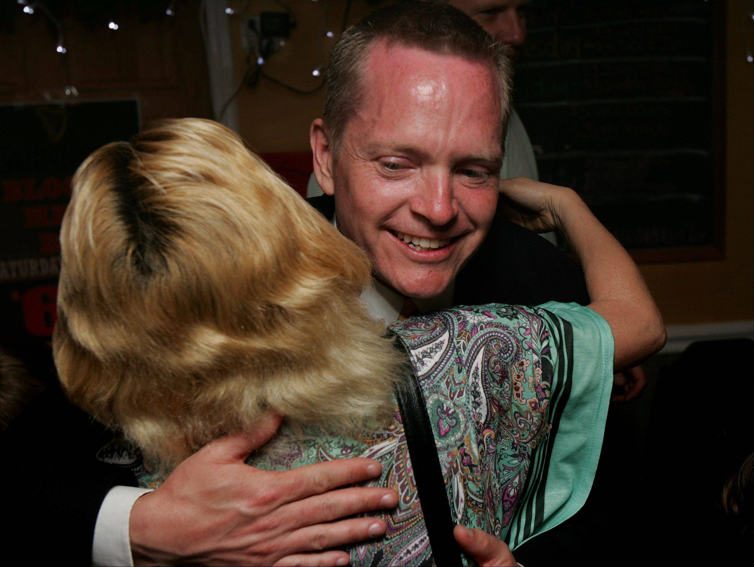 Republican primary candidate Joe Neal hugs Rita Praefke, of Racine, as she congratulates him Tuesday at the Savanna House restaurant in Wadsworth for his win in the primary for the 31st Senate District seat.