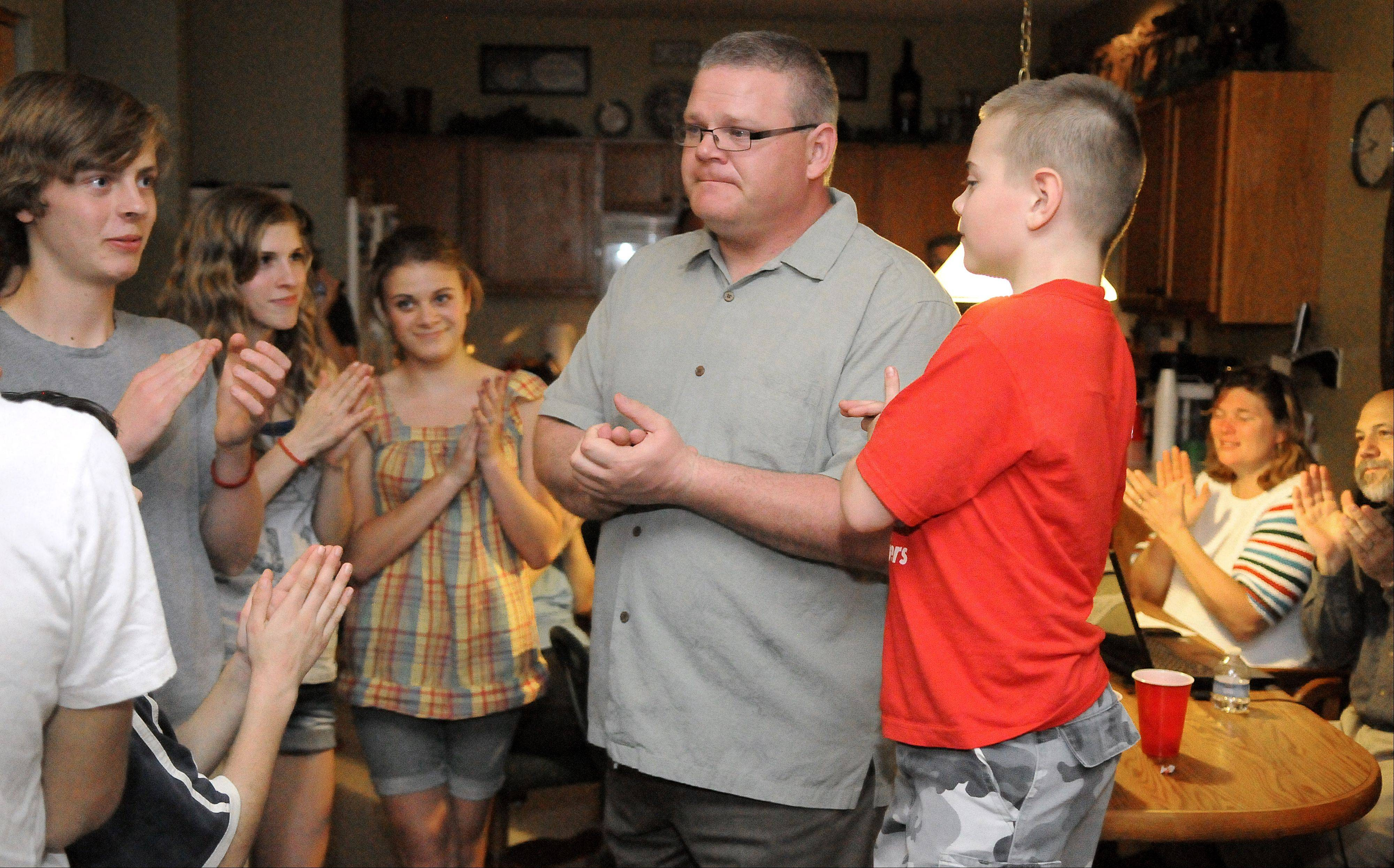 Kane County coroner Republican candidate Rob Russell sheds a tear as he talks to his children and other home-schoolers at his South Elgin home Tuesday, thanking them for their hard work on his campaign to help him win. Son Brock, 9, stands at right and daughter, Brie, 16, at left.