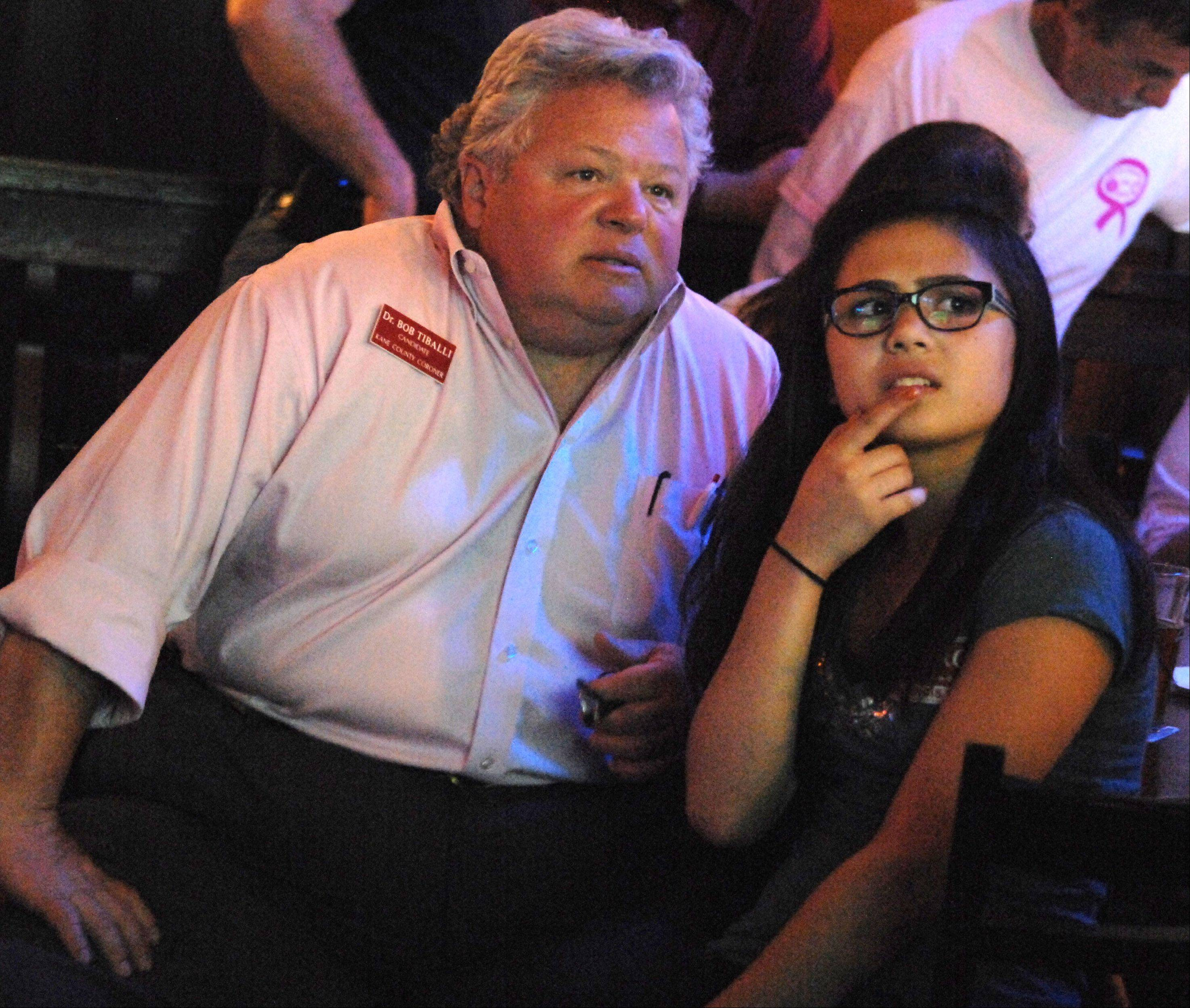 Republican Bob Tiballi watches results for his primary race for Kane County coroner with his daughter Francesca, 14, Tuesday night at Alley 64 in St. Charles.