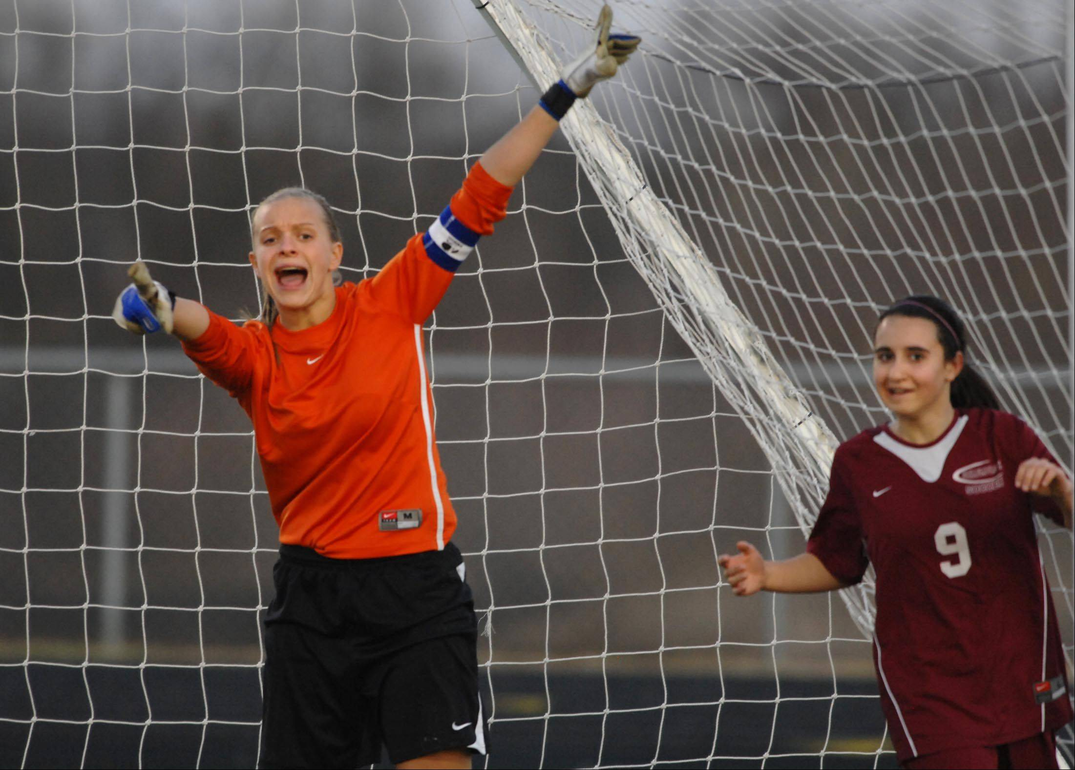Bartlett goalkeeper Natalia Grodzki tries to get the attention of the referee after Schaumburg's Alexa Ben, right, scored a goal Monday in Streamwood.