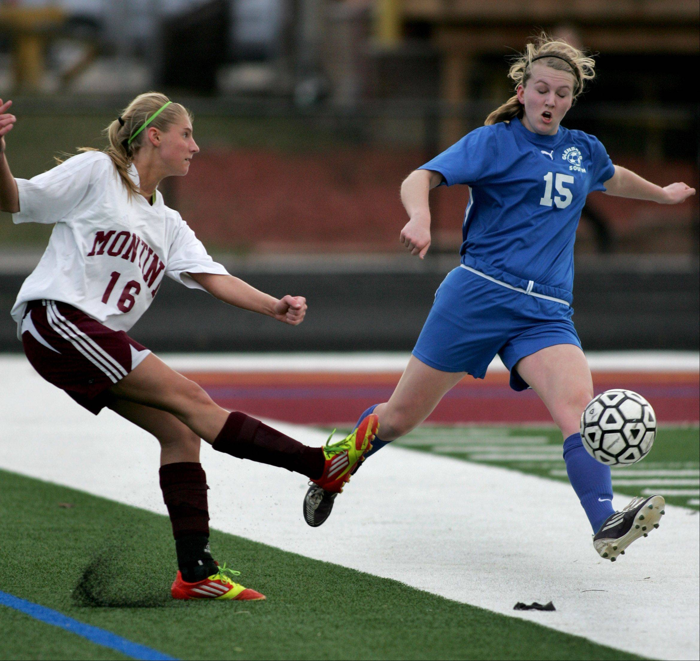Montini's Jessie Bejna, left, kicks the ball away from Glenbard South Nicole Schutte during Monday's soccer game in Lombard.