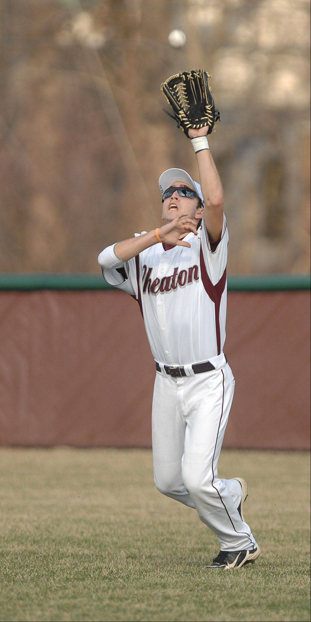 Wheaton Academy's Michael Kuppler grabs a fly ball during Wednesday's game against Gelnbard West.