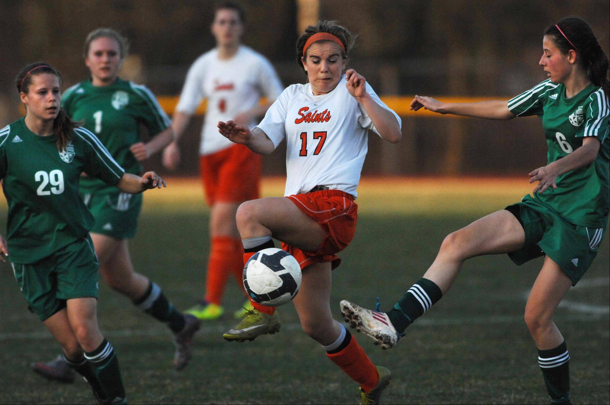 St. Charles East's Anna Corirossi steps in front of a pass from St. Edward's Chelsea Gnan to teammate Megan Kearney Thursday in St. Charles.