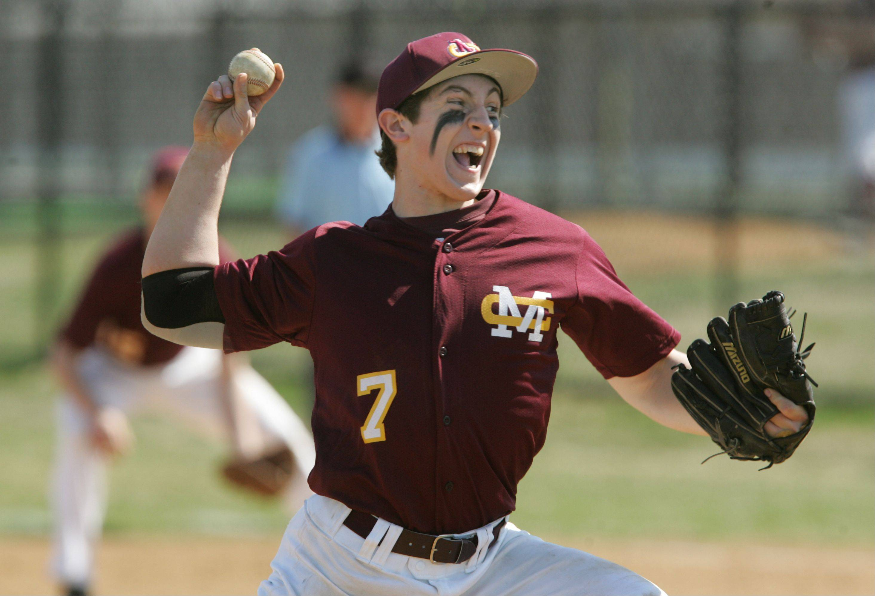Montini's Mike Mangialardi delivers a pitch against Addison Trail during opening day baseball action.