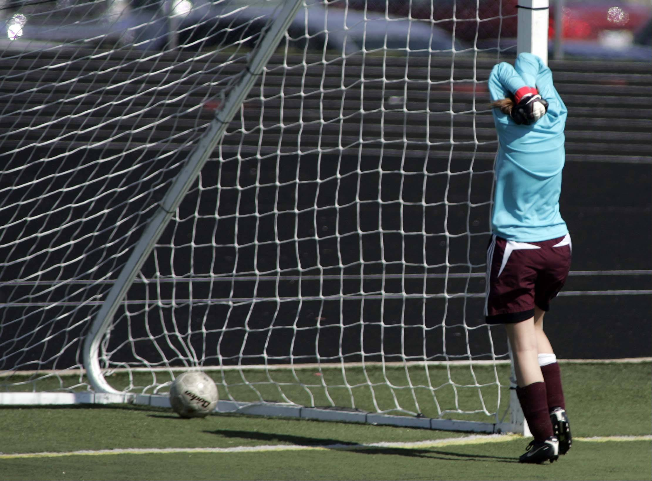 Montini goalie Kiera Johnston, reacts after Bartlett's third goal during Saturday's soccer game in Streamwood.