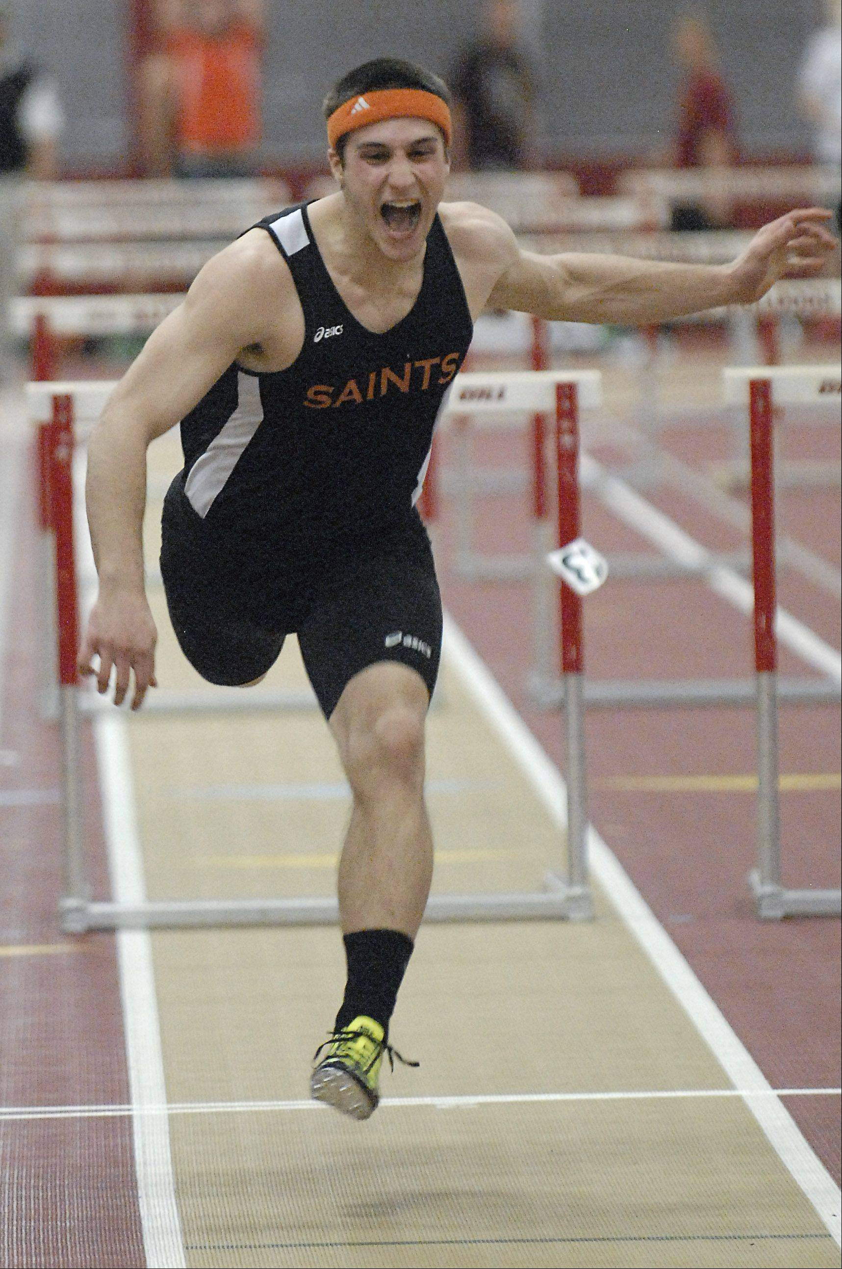 St. Charles East's Nick Devor screams to the finish line in the 55-meter dash final at the Upstate Eight meet in Batavia on Friday.