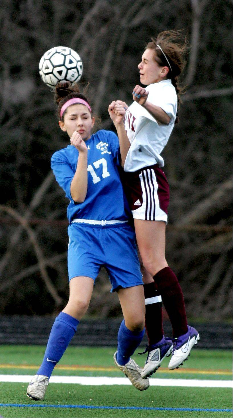 Glenbard South's Dana Langel, left and Montini's Haley Werner battle for the ball during Monday's soccer game in Lombard.