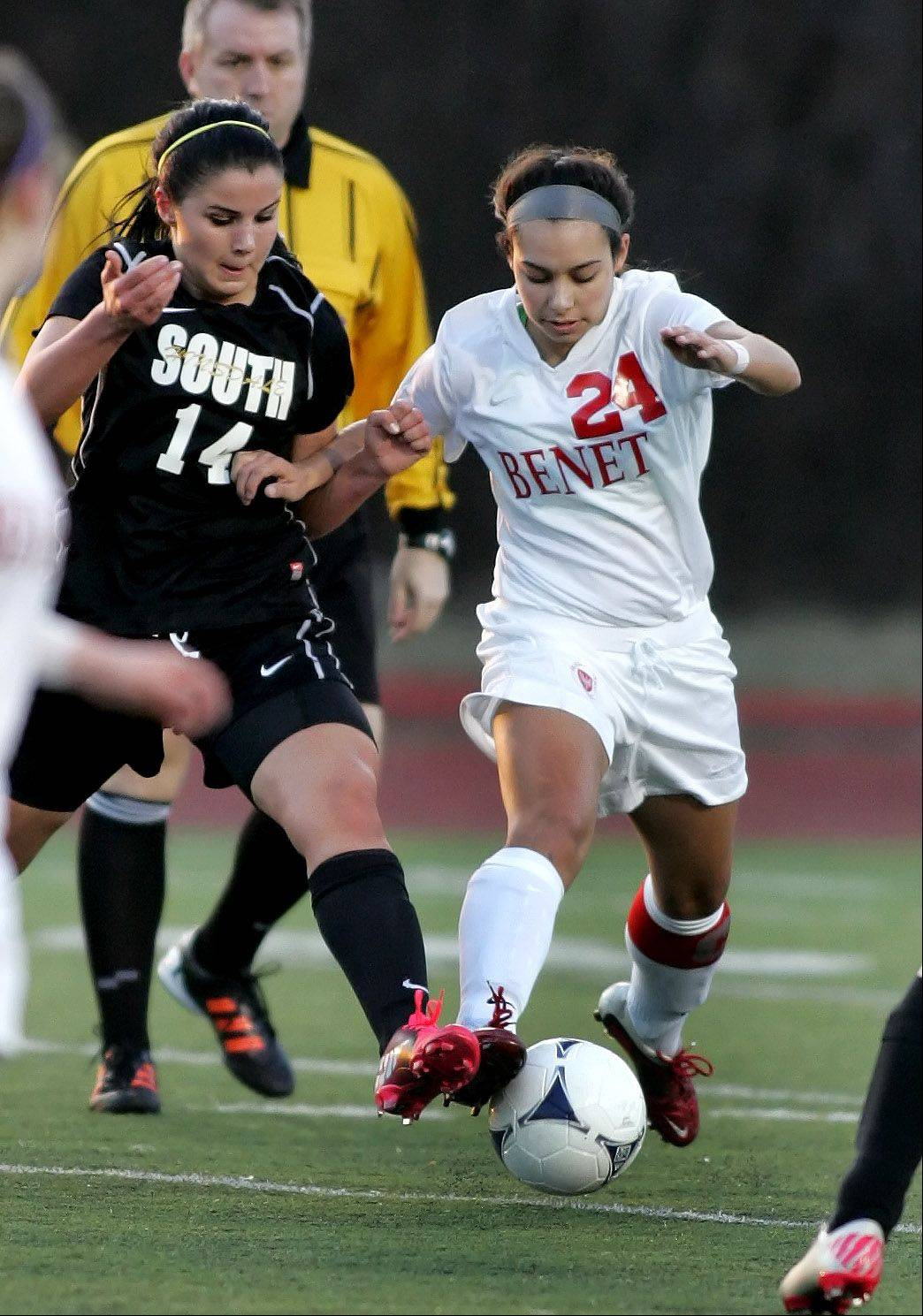Benet's Jamei Borges, right, takes control of the ball from Hinsdale South's Maggie Nicosia Tuesday's soccer game in Lisle.